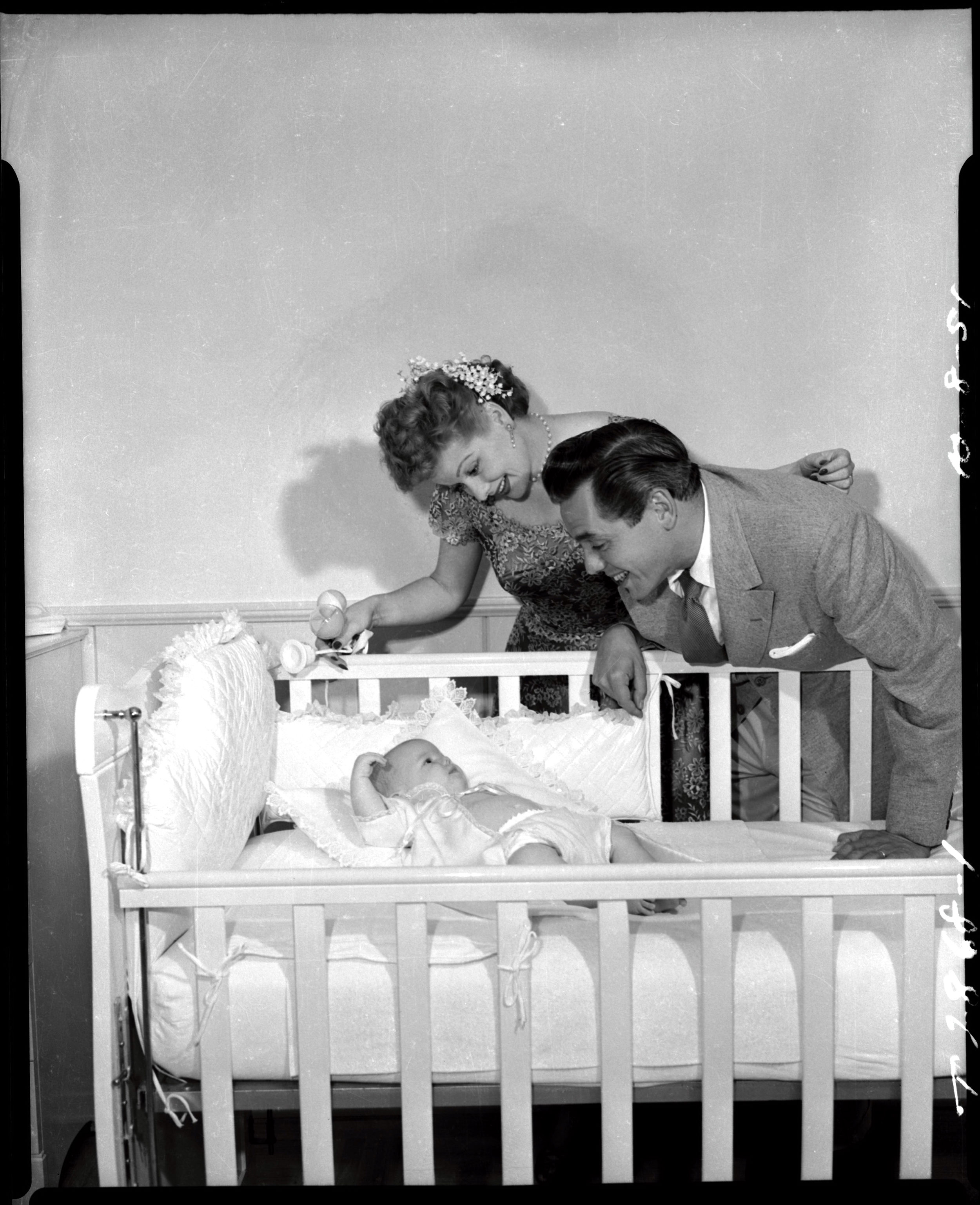 I Love Lucy  promotional shot of Lucille Ball and Desi Arnaz and their child, Lucy Desiree Arnaz.