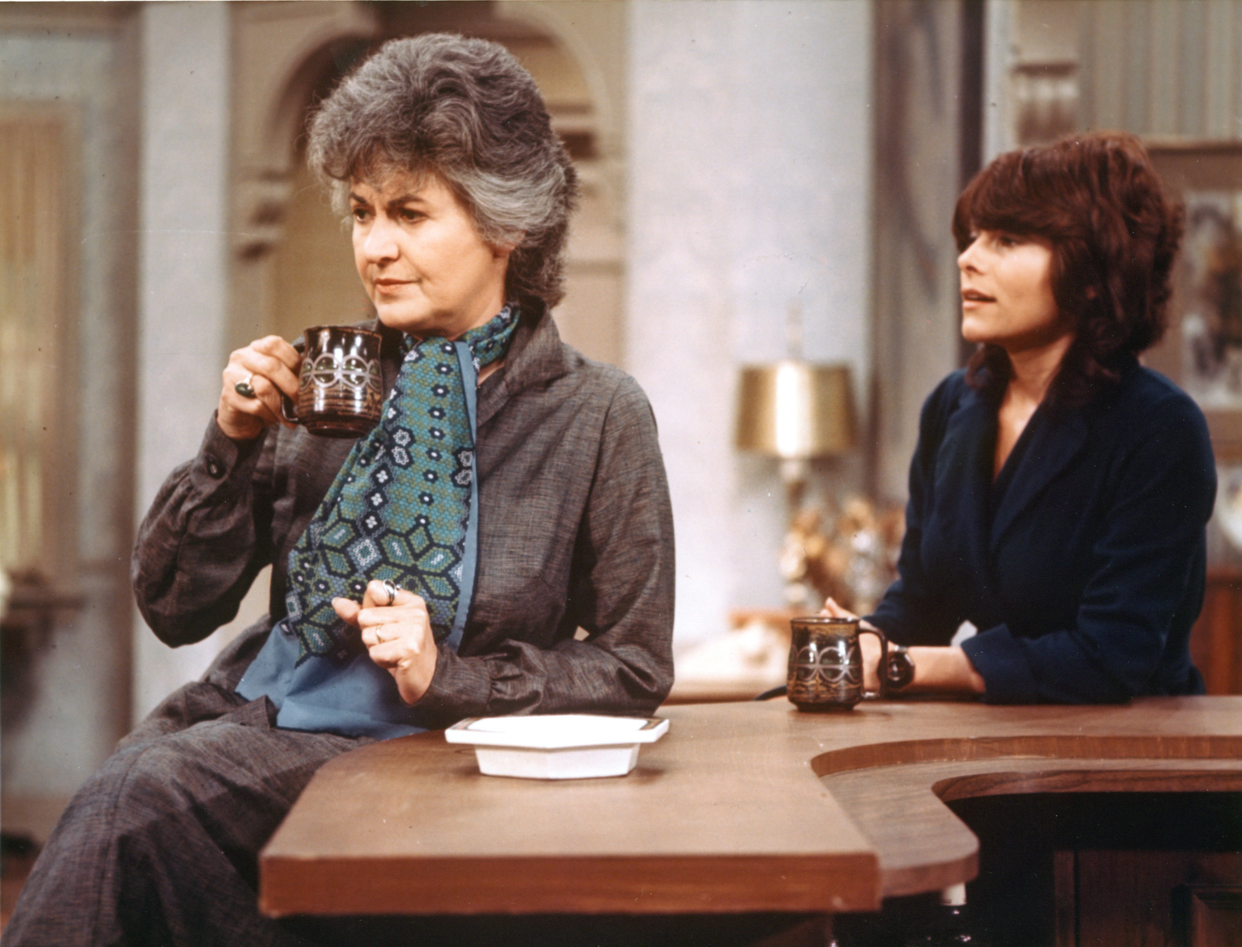 Cast members Beatrice Arthur (as Maude Findlay) and Adrienne Barbeau (as Carol) in  Maude  in 1975.