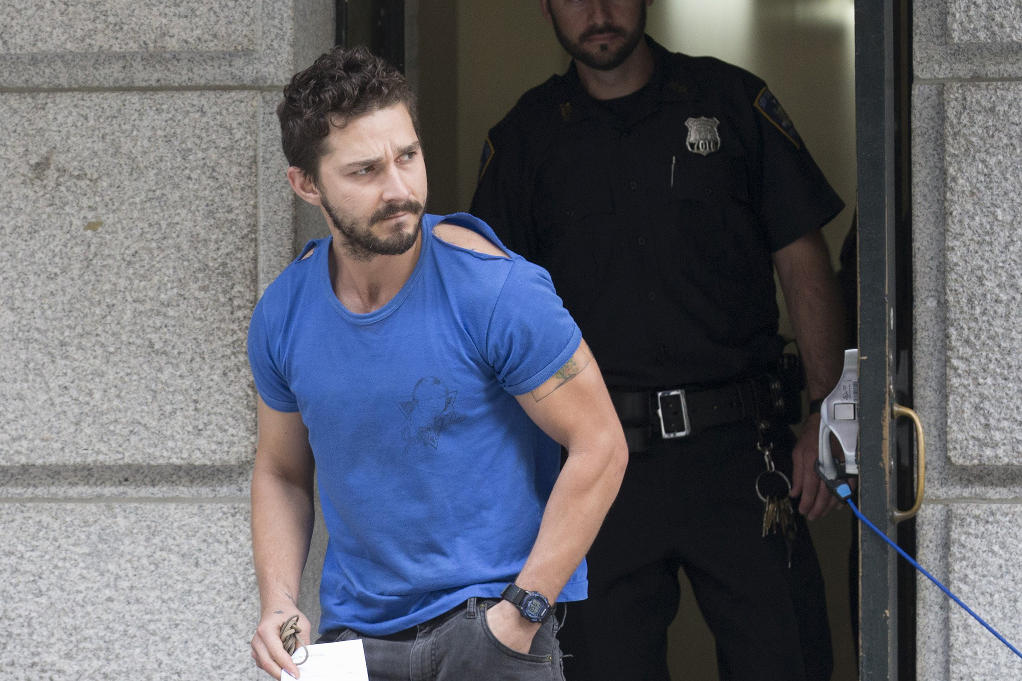 Actor Shia LaBeouf leaves Midtown Community Court after being arrested the previous day for yelling obscenities at the Broadway show  Cabaret,  June 27, 2014, in New York.