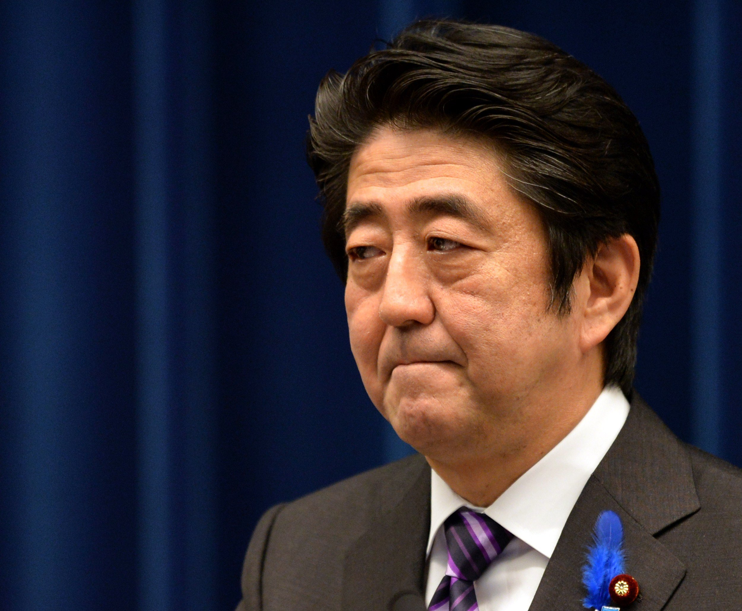 Japanese Prime Minister Shinzo Abe speaks during a press conference at his official residence in Tokyo on July 1, 2014.