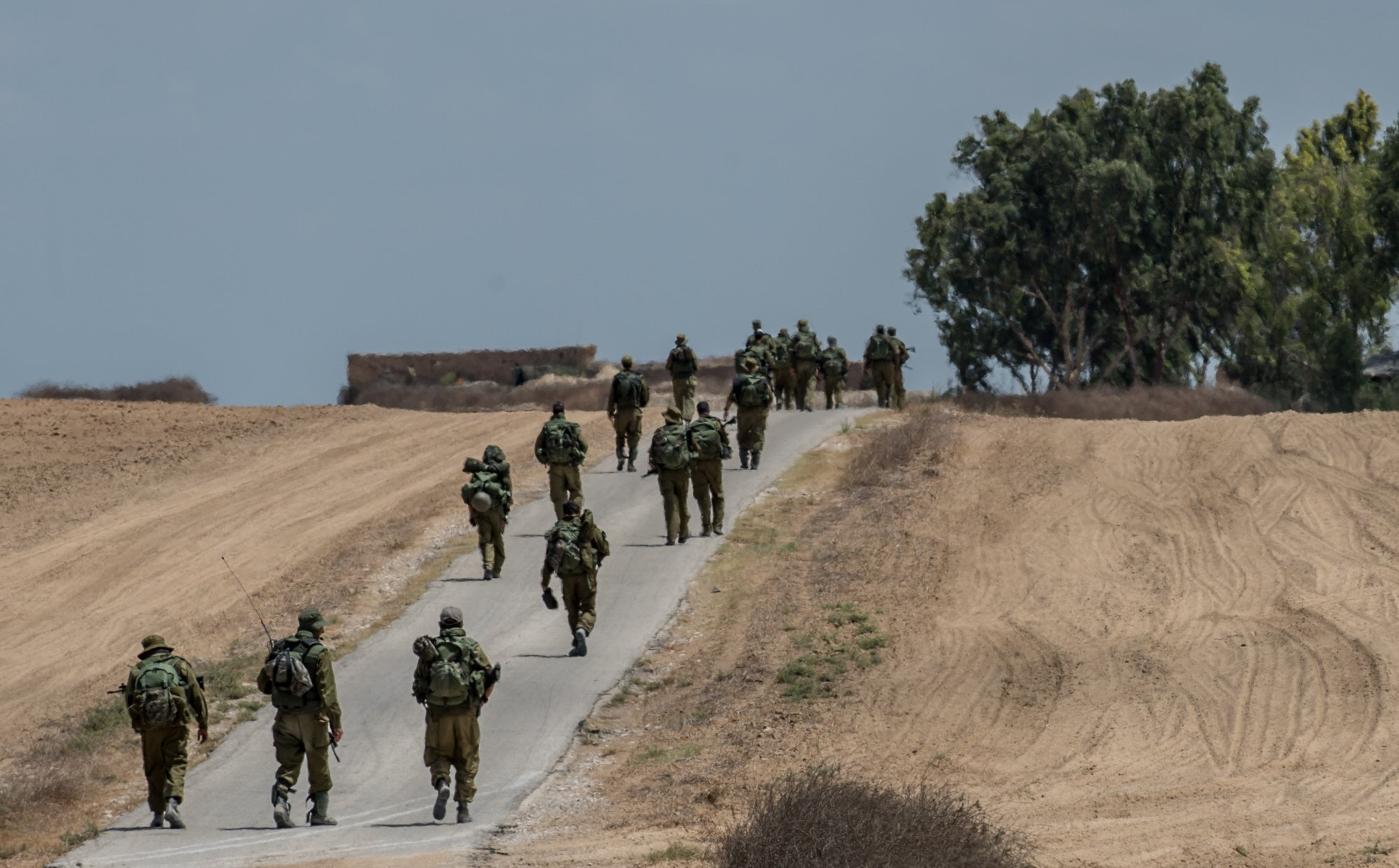 Israeli soldiers march in southern Israel near the border with Gaza, on July 18, 2014, the 11th day of Operation Protective Edge.