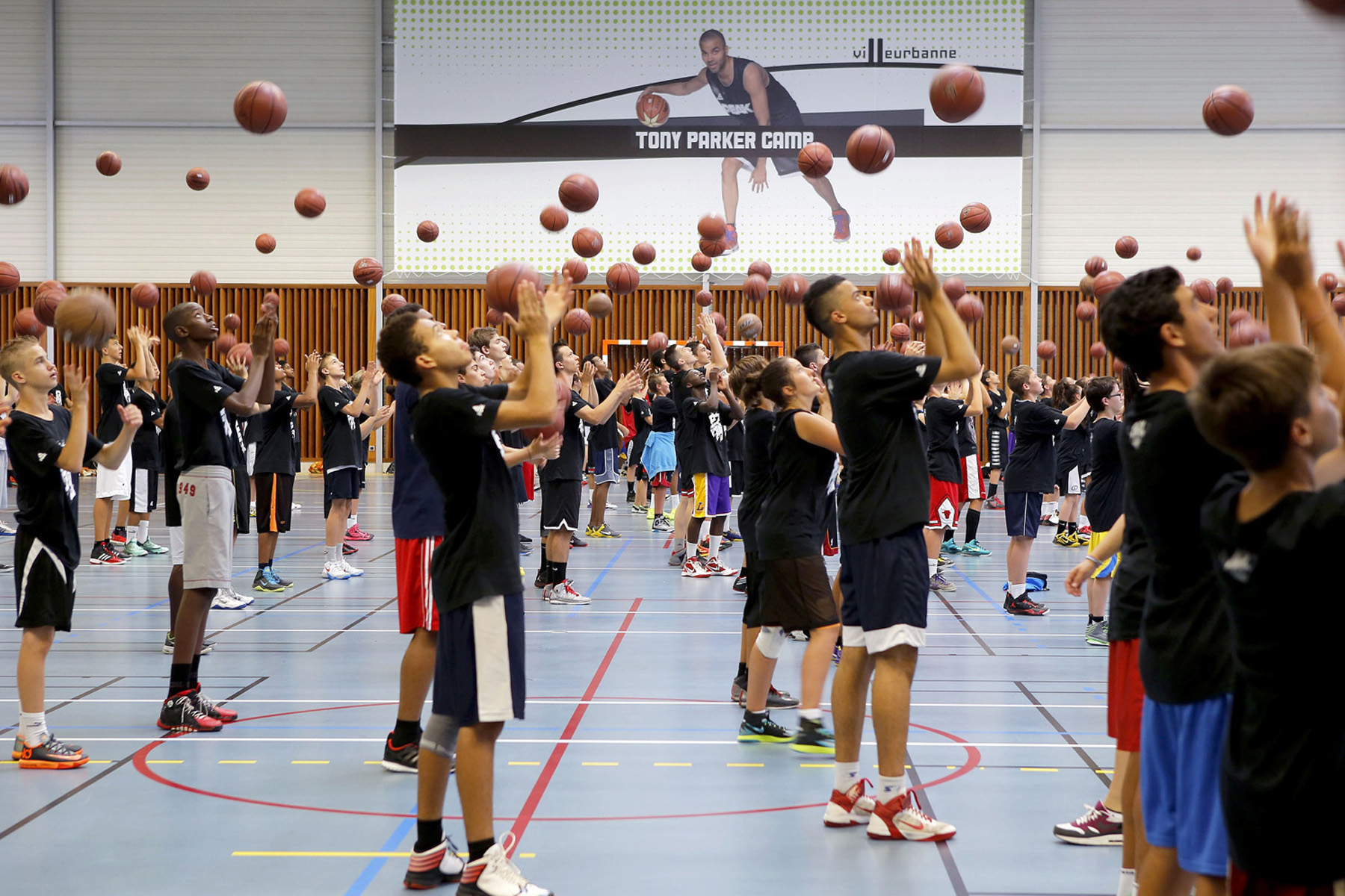 A training session at the 'Tony Parker Camp', a teen summer basketball camp  in Villeurbanne, France, on July 21, 2014.