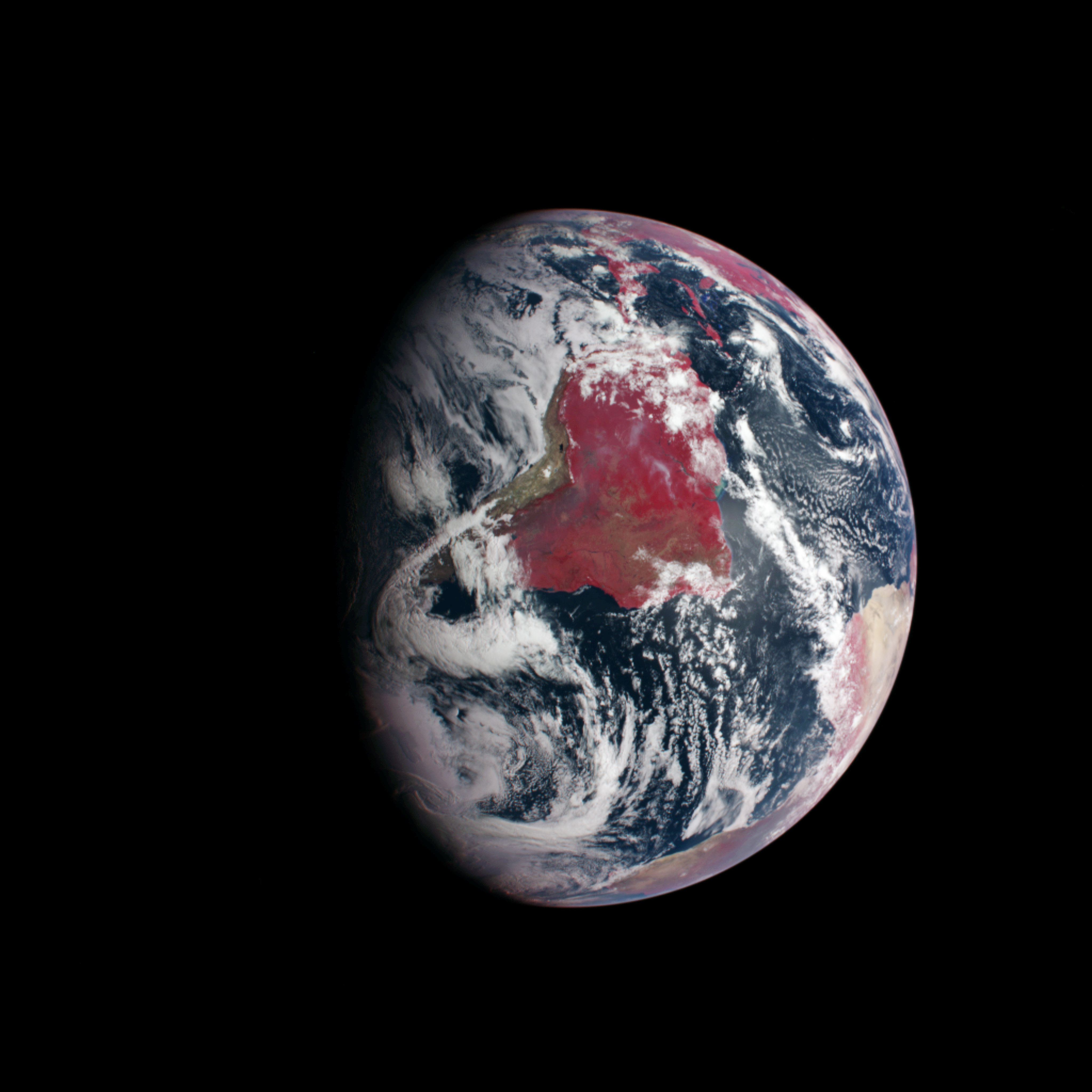 A view of earth from MESSENGER's Dual Imaging System. The wide-angle camera records light at eleven different wavelengths, including visible and infrared light. The image above substitutes infrared light for blue light