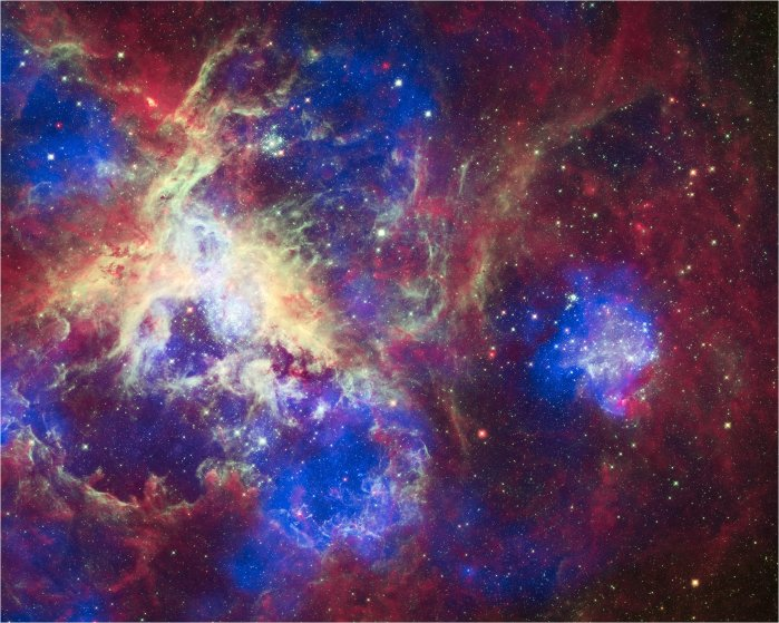 This composite of 30 photos of theTarantula Nebula, contains data from Chandra (blue), Hubble (green), and Spitzer (red).  Located in the Large Magellanic Cloud, the Tarantula Nebula is one of the largest star-forming regions close to the Milky Way.