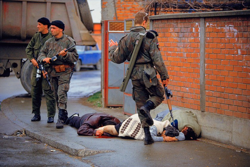 Arkan's Tigers kill and kick Bosnian Muslim civilians during the first battle for Bosnia in Bijeljina, Bosnia on March 31, 1992. T
