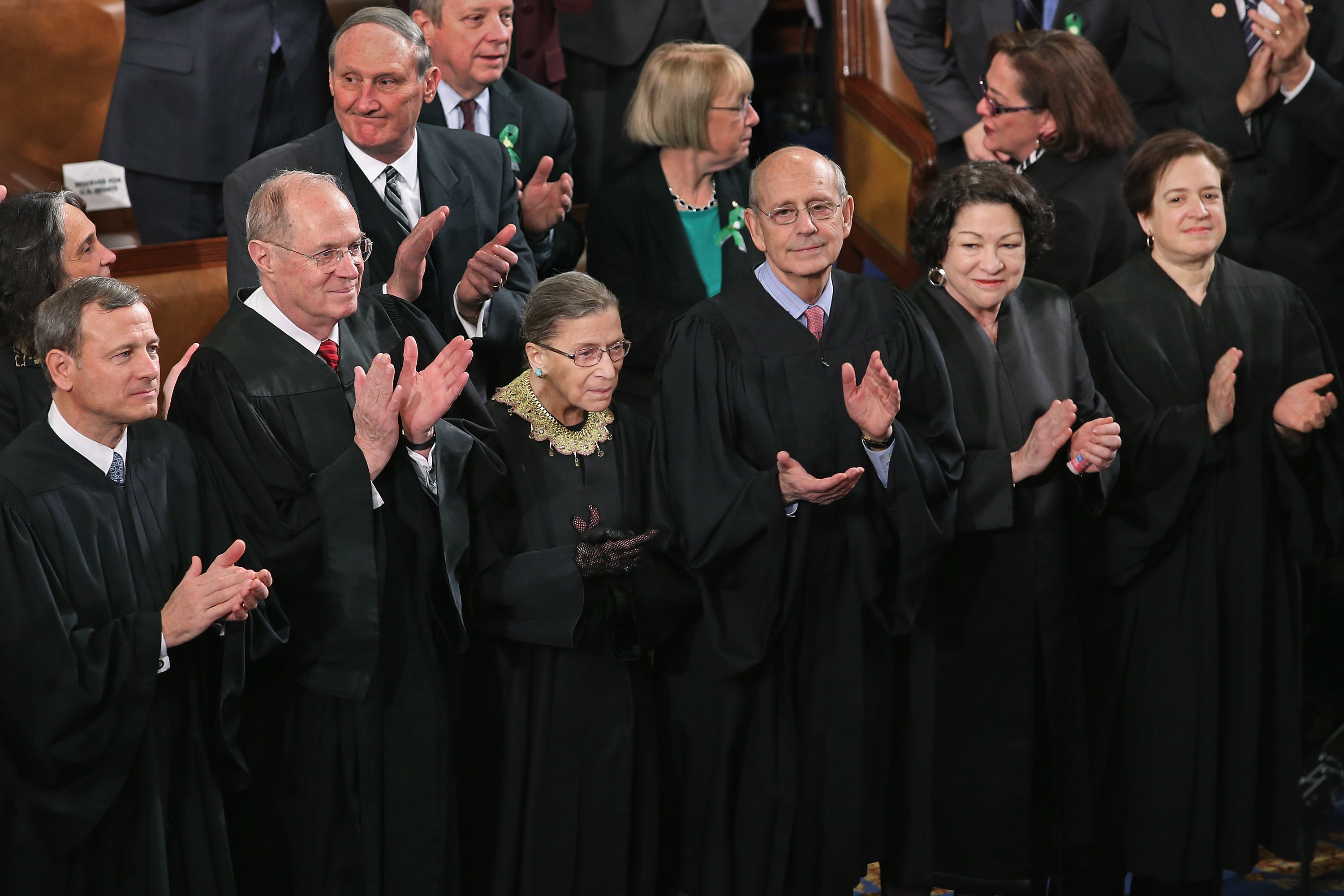 Members of the Supreme Court, (L-R) Chief Justice John Roberts and associate justices Anthony Kennendy, Ruth Bader Ginsburg, John Paul Stevens, Sonia Sotomayor and Elena Kagan, applaud as U.S. President Barack Obama arrives to deliver his State of the Union speech before a joint session of Congress at the U.S. Capitol in Washington on February 12, 2013.