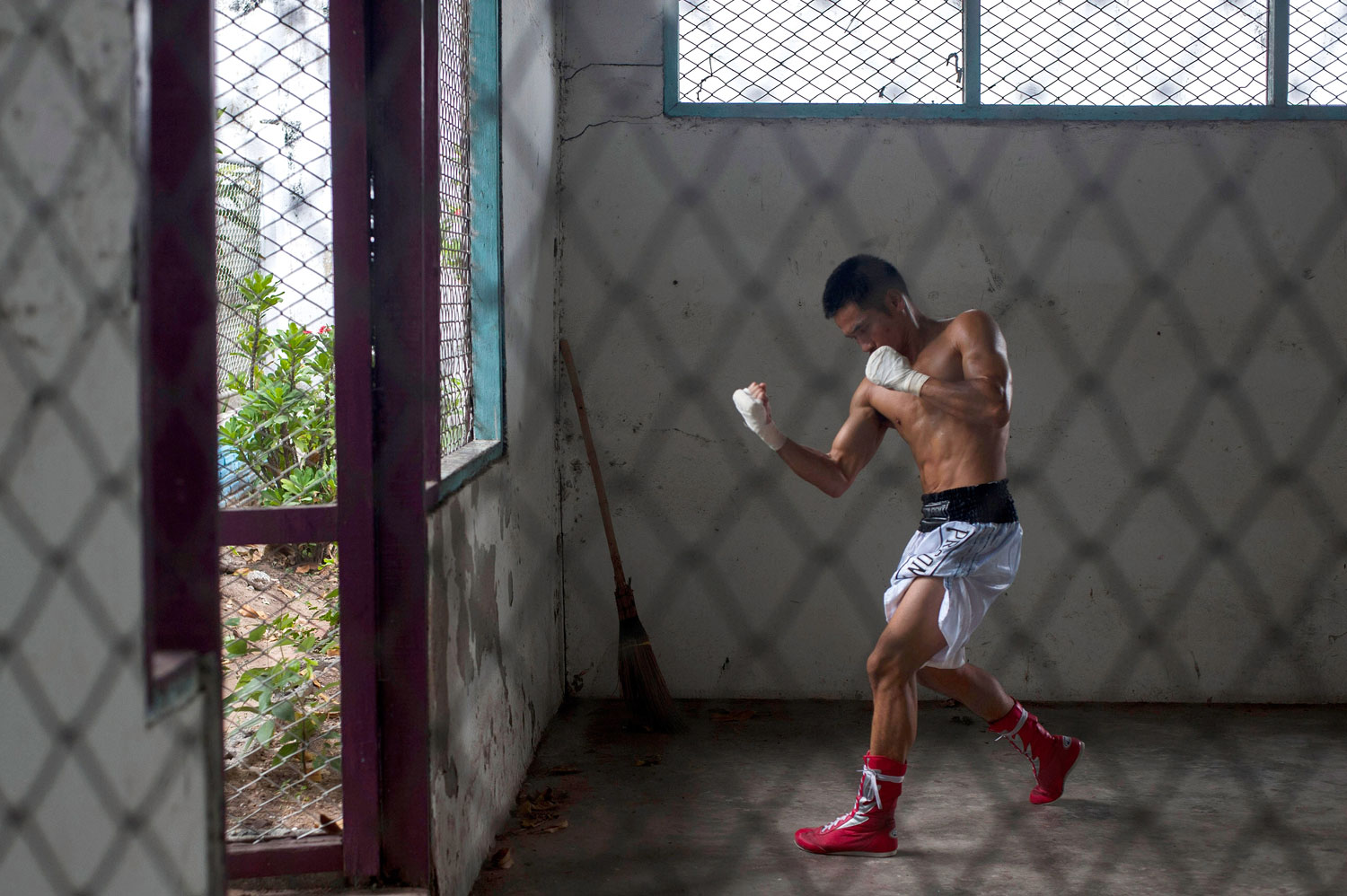 An inmate prepares himself before his fight at Klong Pai prison on July 12, 2014 in Nakhon Ratchasima, Thailand.