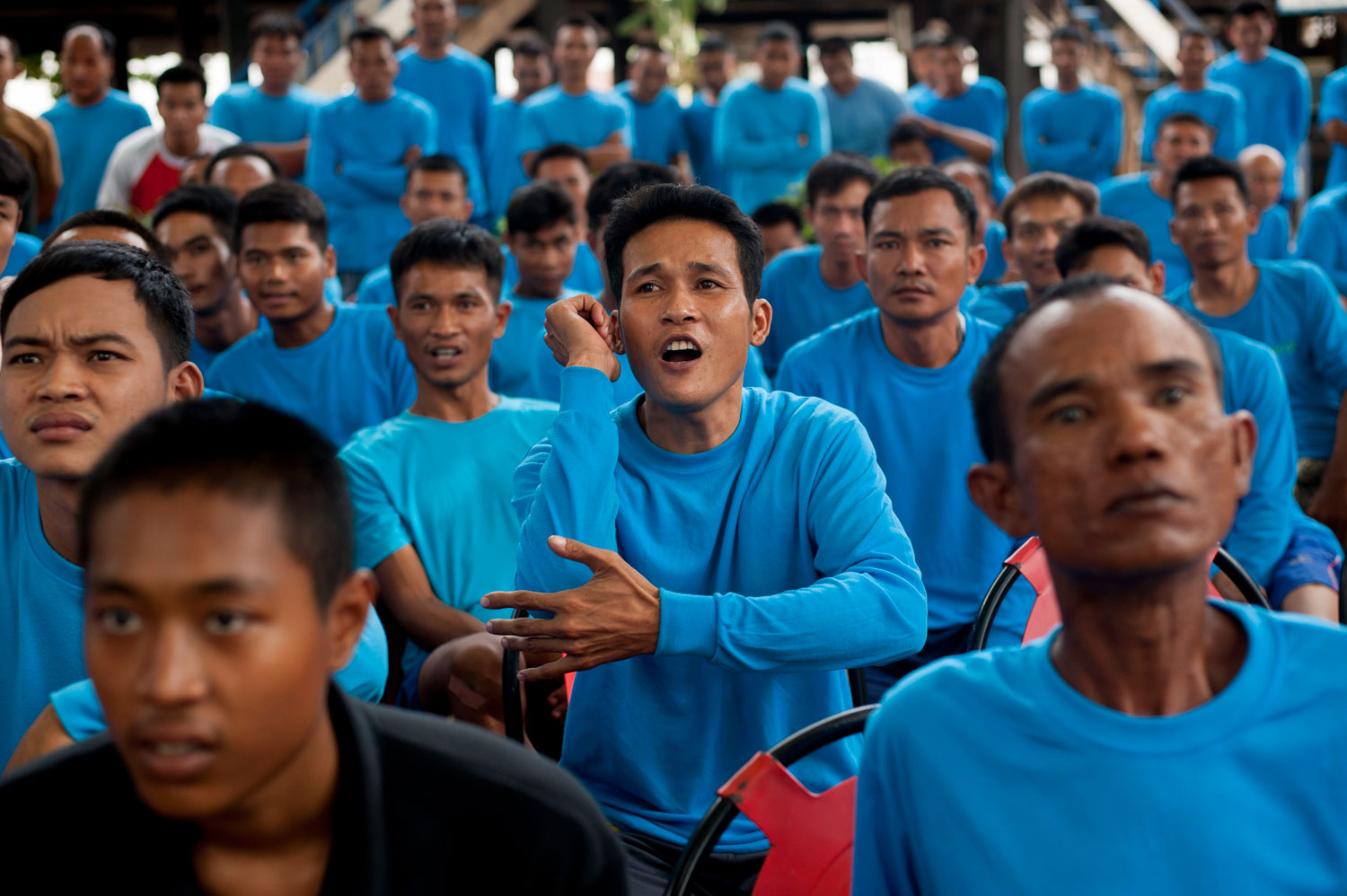 Inmates react during a Muay Thai fight at Klong Pai prison on July 12, 2014 in Nakhon Ratchasima, Thailand.