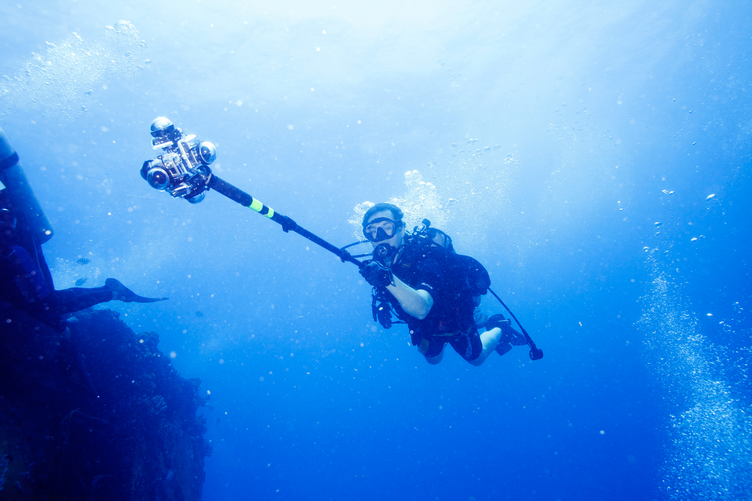 TIME Senior Editor Jonathan D. Woods is seen holding a 360Heros scuba rig as he shoots a 360 video of Aquarius Reef Base on June 15, 2014.
