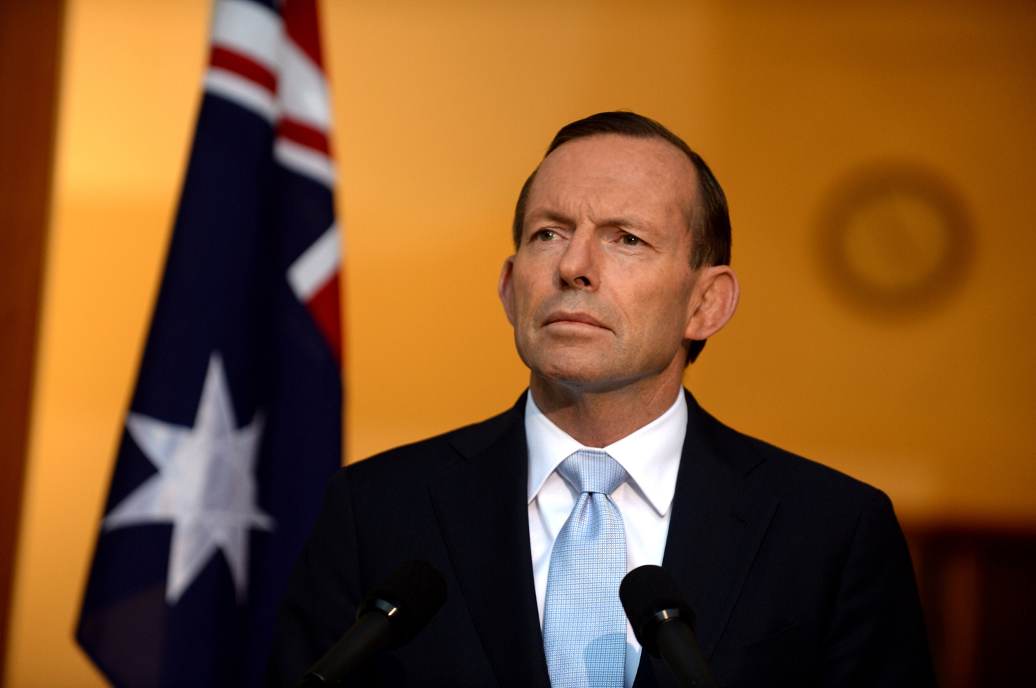Australian Prime Minister Tony Abbott speaks about the downing of Malaysia Airlines Flight 17 in Ukraine during a press conference in Canberra, Australia on July 18, 2014.