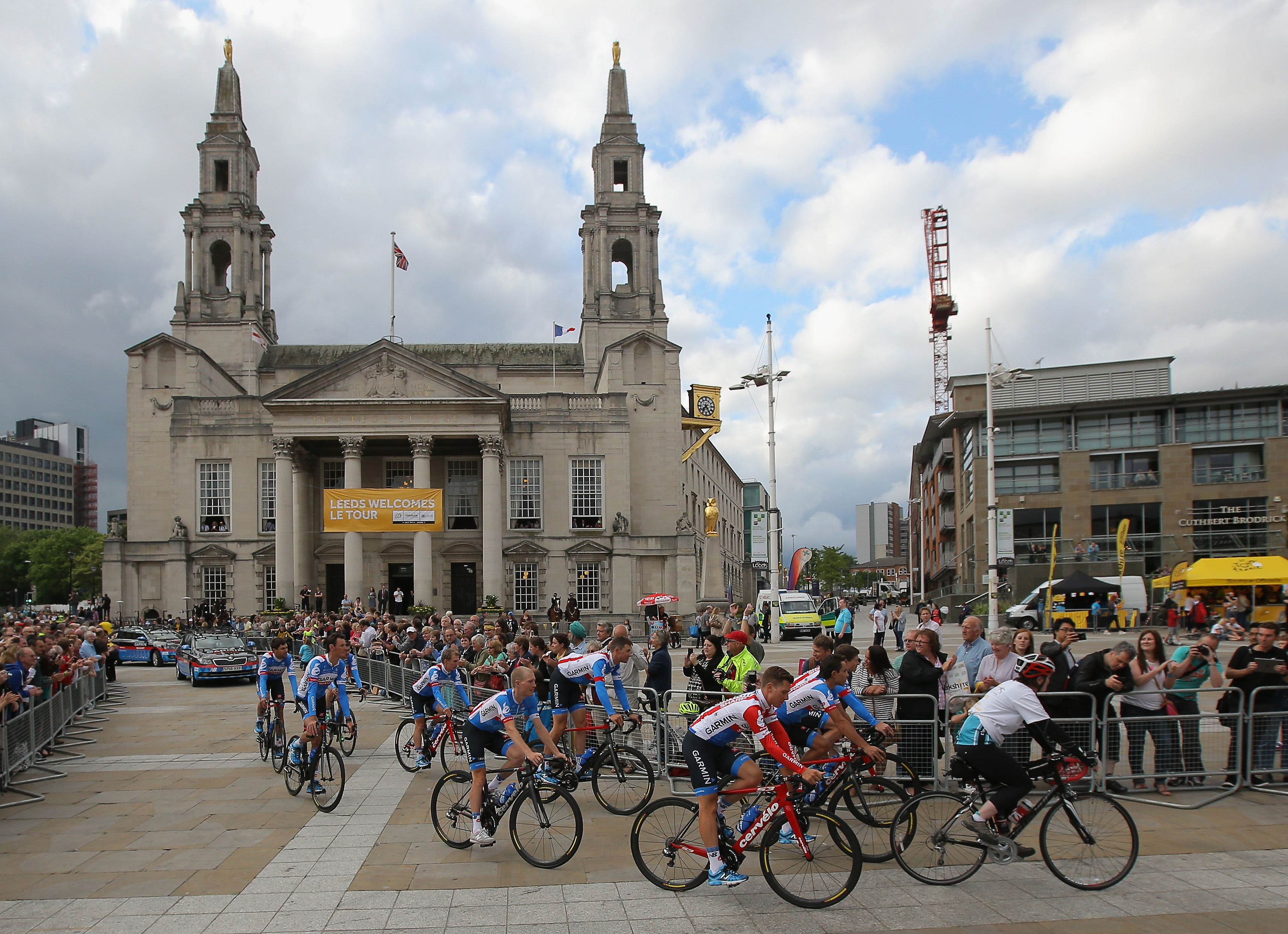 Team Garmin-Sharp is greeted by supporters as they ride through Millenium Square enroute to the Team Presentation prior to the 2014 Le Tour de France on July 3, 2014 in Leeds, United Kingdom.