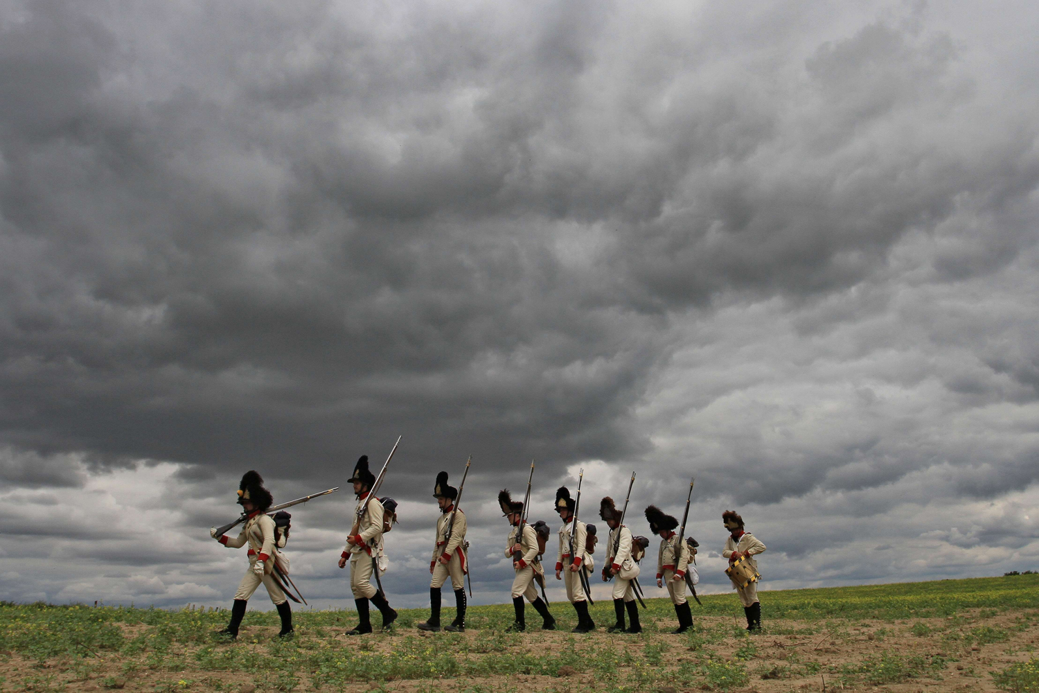 Jul. 10, 2014. Participants dressed as soldiers of the Austrian Empire fire their guns as they take part in the reenactment of the historic Napoleonic march from Seefeld-Kadolz, Austria to Dobsice, Czech Republic.