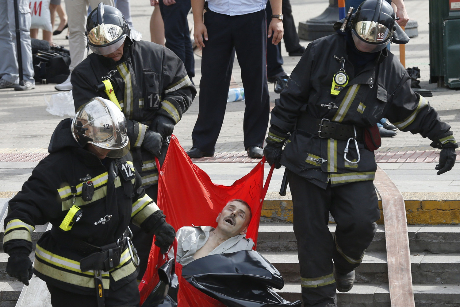 Jul. 14, 2014. Rescuers carry a passenger injured as several subway cars derailed in Moscow. At least twelve people died and scores were taken to hospital today after a train derailed in the Moscow metro in a tunnel between Park Pobedy and Slavyansky Bulvar stations, in the west of Moscow.