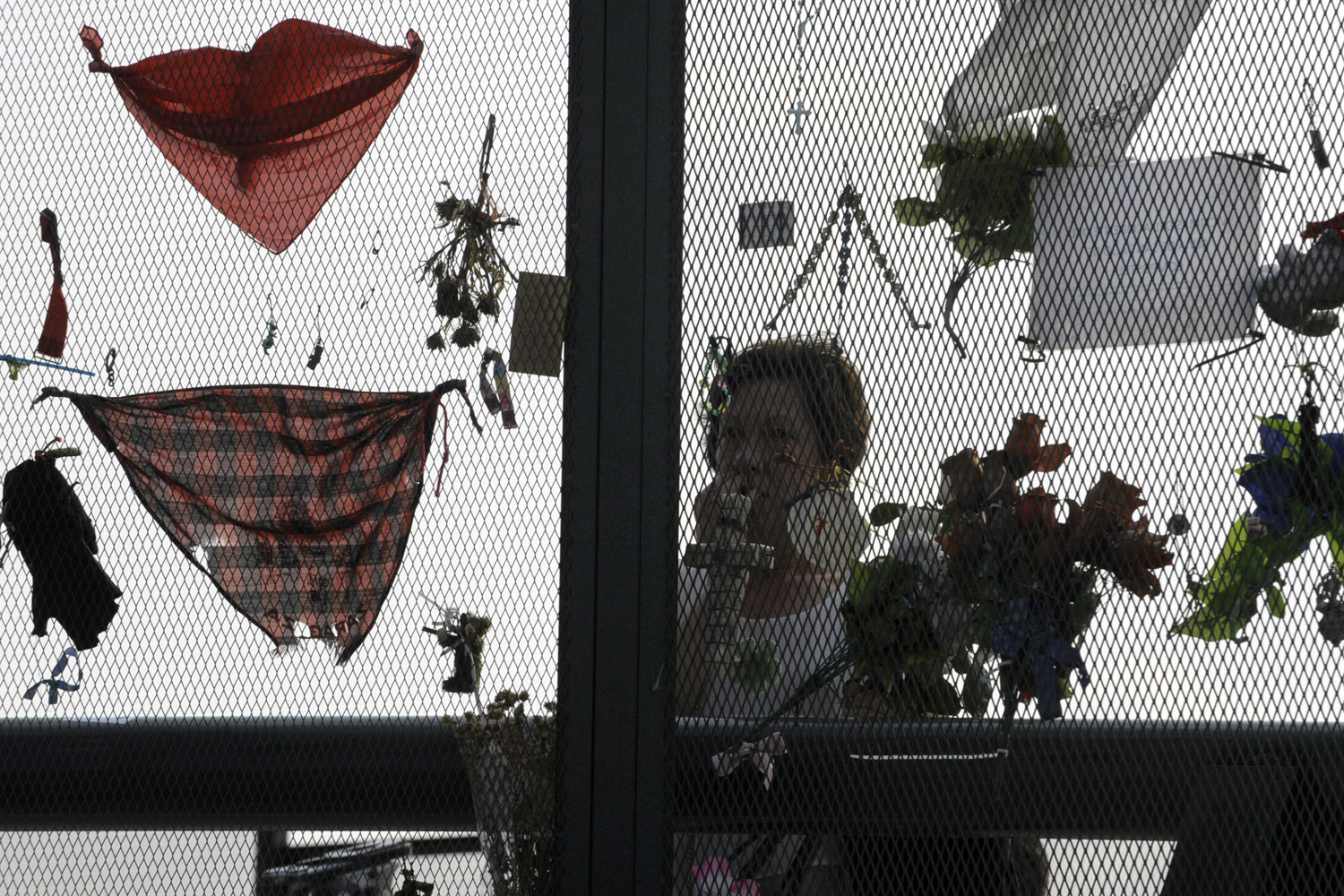 Jul. 24, 2014. A relative of victims of the Santiago de Compostela train crash pays tribute on the first anniversary at the site of the accident in Angrois, near Santiago de Compostela, Spain.