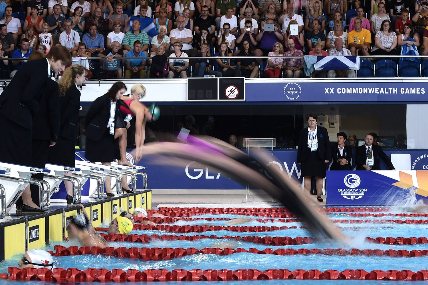 Jul. 26, 2014. Swimmers dive in during the Women's 4 x 200m Freestyle Relay Final at the Tollcross International Swimming Centre during the 2014 Commonwealth Games in Glasgow.