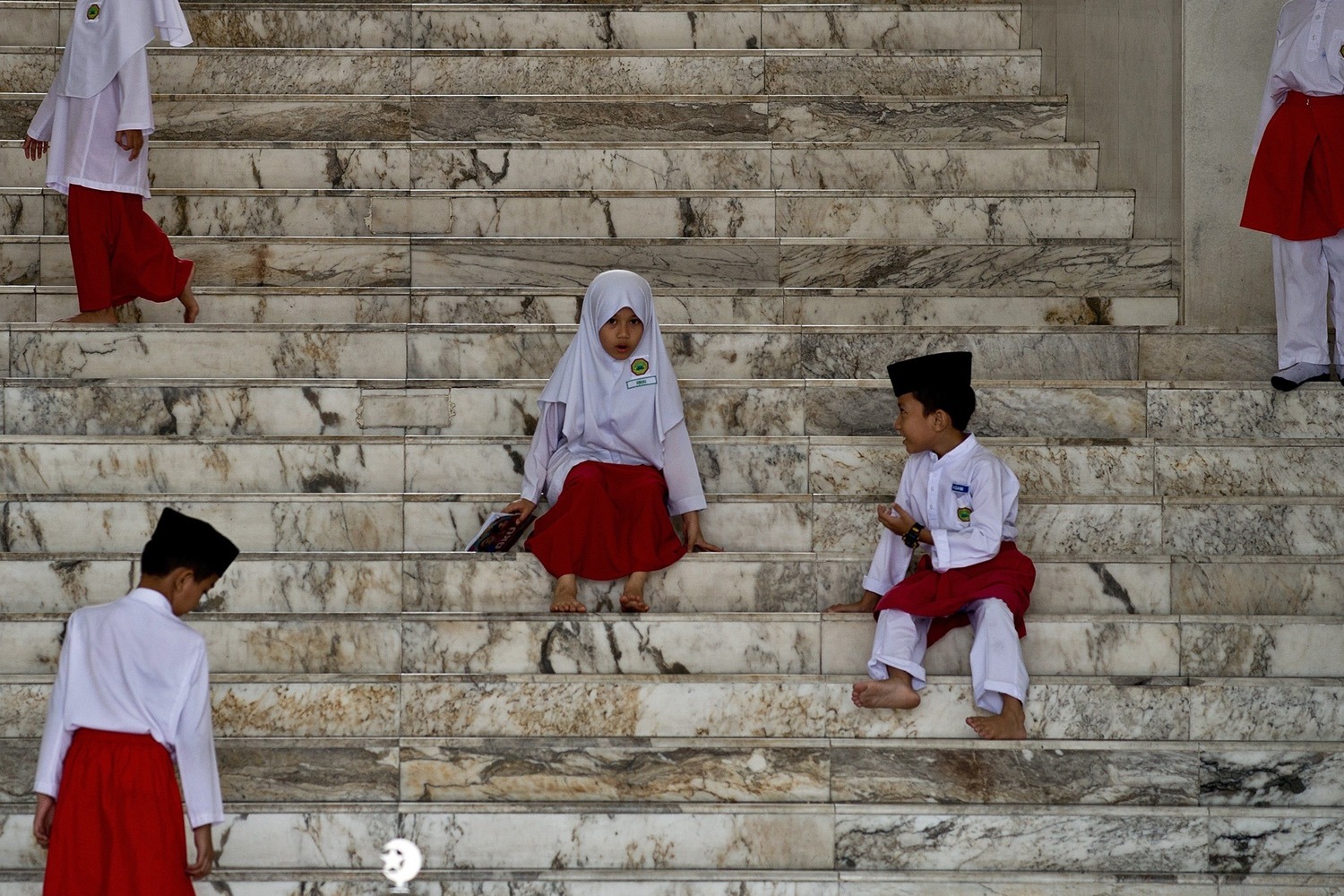 Jul. 2, 2014. Young Malaysian Muslim children play on the steps of a mosque after attending their classes during the Islamic month of Ramadan in Kuala Lumpur.