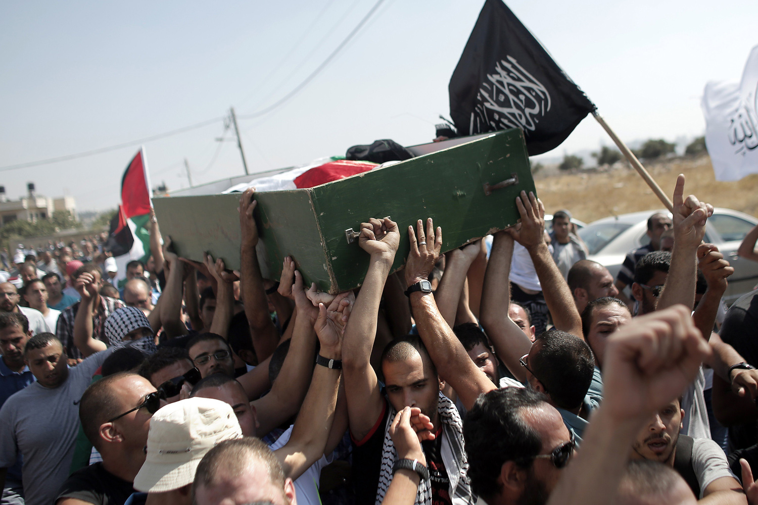 Jul. 4, 2014. Relatives and friends of Mohammed Abu Khder, 16, carry his body to the mosque during his funeral in Shuafat, in Israeli annexed East Jerusalem.