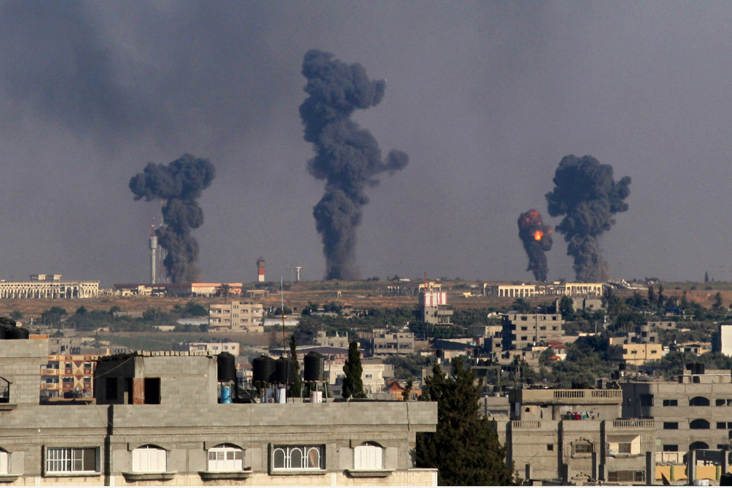 Jul. 7, 2014. A ball of fire is seen following an Israel airstrike on Gaza International Airport in Rafah, southern Gaza. Israeli air strikes on Gaza killed eight Palestinian militants, medics said after recovering several bodies from a collapsed tunnel in Rafah.
