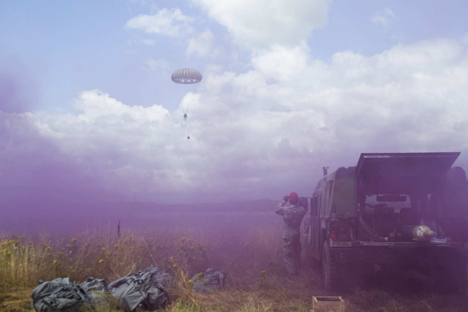 Jul. 1, 2014. A US army soldier of the second Squadron, 38th Cavalry Regiment (2-38th CAV), part of the NATO-led peacekeeping mission in Kosovo , KFOR,  jumps with parachute as other throw smoke grenades during a US military exercise near the town of Gjakova.