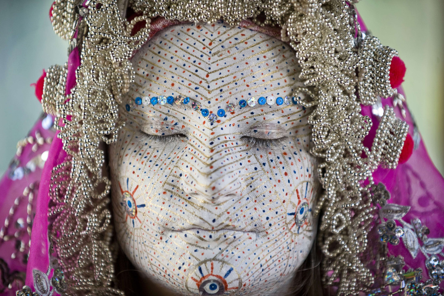 Jul. 2, 2014. Kosovar Bosnian woman Arleta Sahiti poses after her face was painted by a woman during a presentation of the traditional wedding ceremony of Bosnian women from Zhupa region at the Ethnological Museum in Pristina.