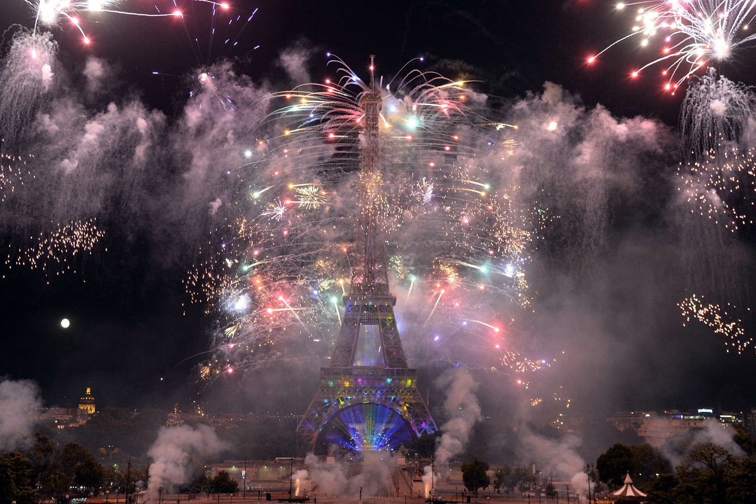 Fireworks burst around the Eiffel Tower as part of France's annual Bastille Day celebrations in Paris on July 14, 2014.