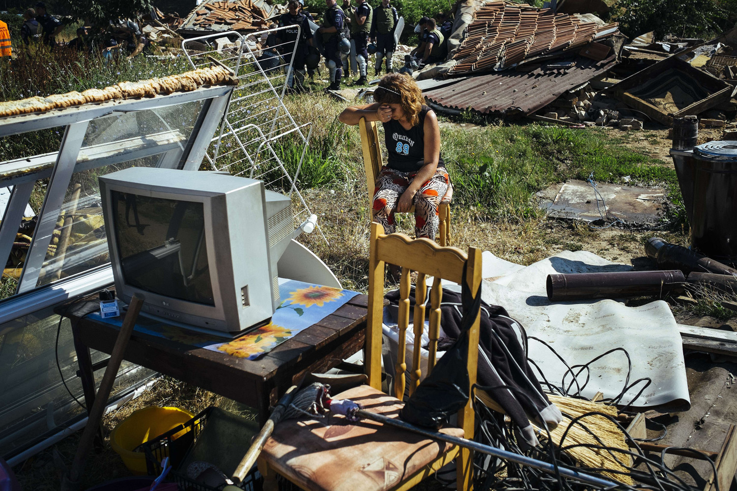 Jul. 21, 2014. A Roma woman reacts after a bulldozer demolished her house in a Roma suburb in the town of Stara Zagora.