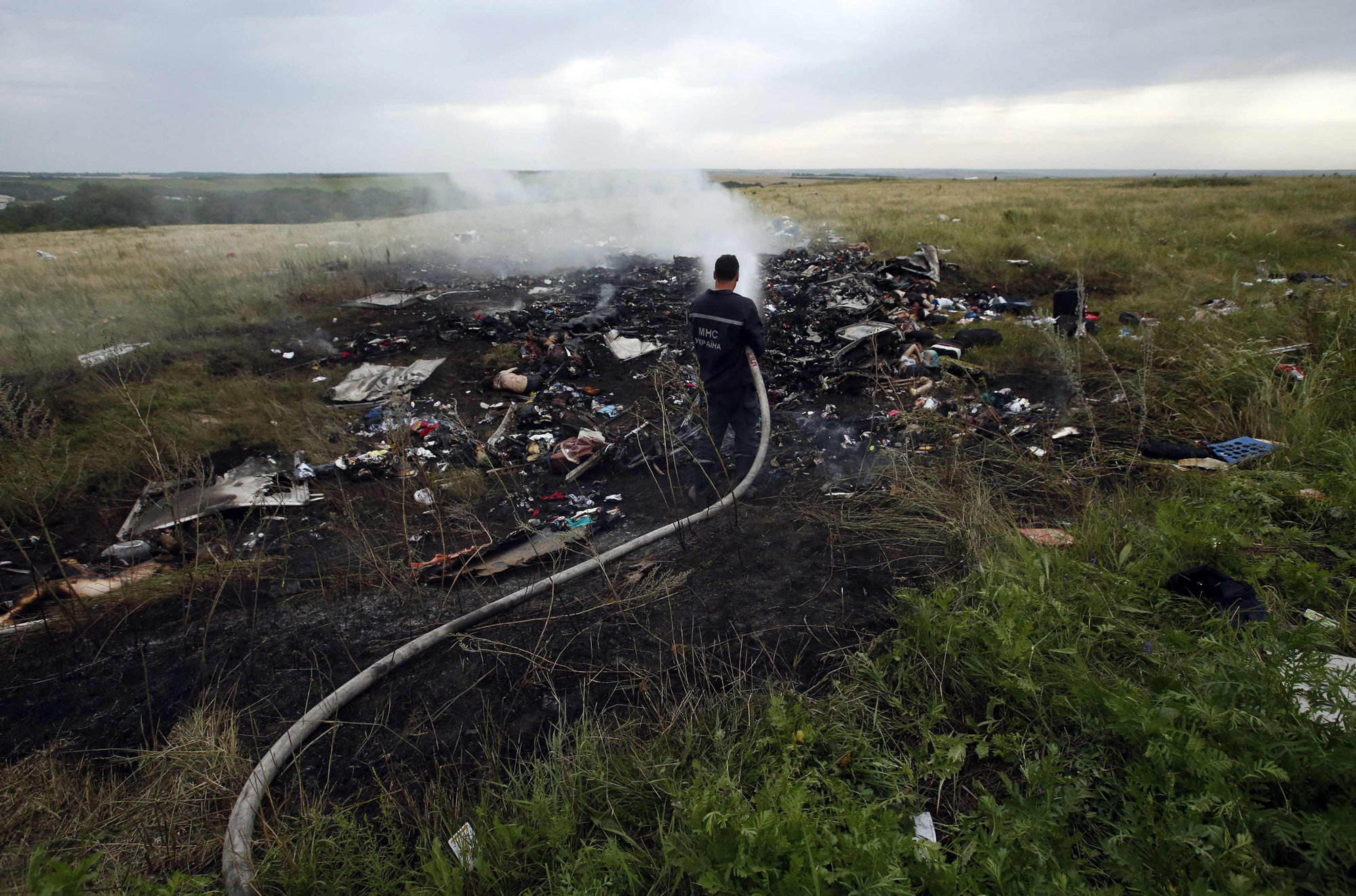 An Emergencies Ministry member works at putting out a fire at the site of a Malaysia Airlines Boeing 777 plane crash in the settlement of Grabovo in the Donetsk region, July 17, 2014.
