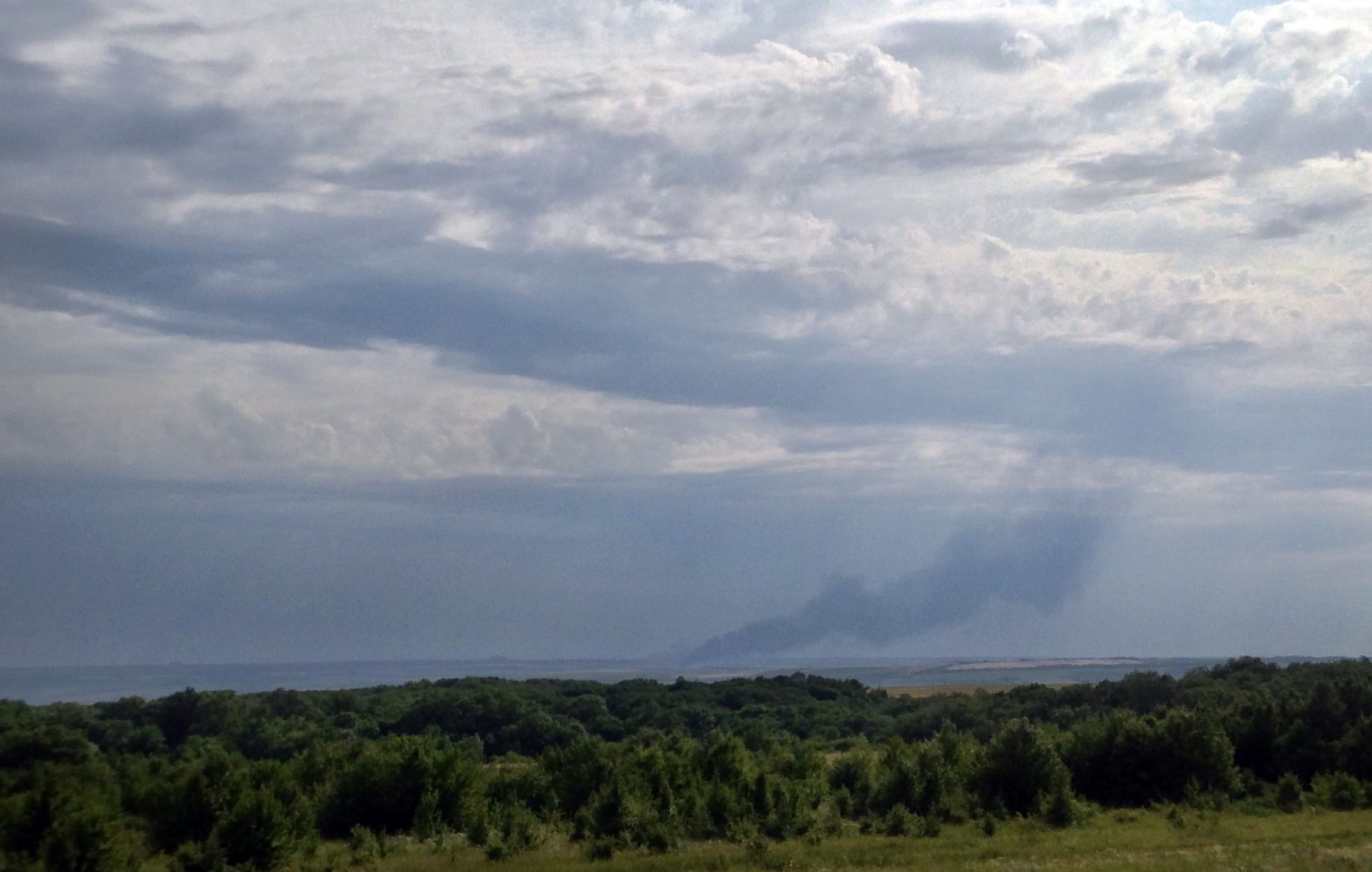 Smoke rises from where a Malaysia Airlines commercial plane crashed in eastern Ukraine on July 17, 2014.