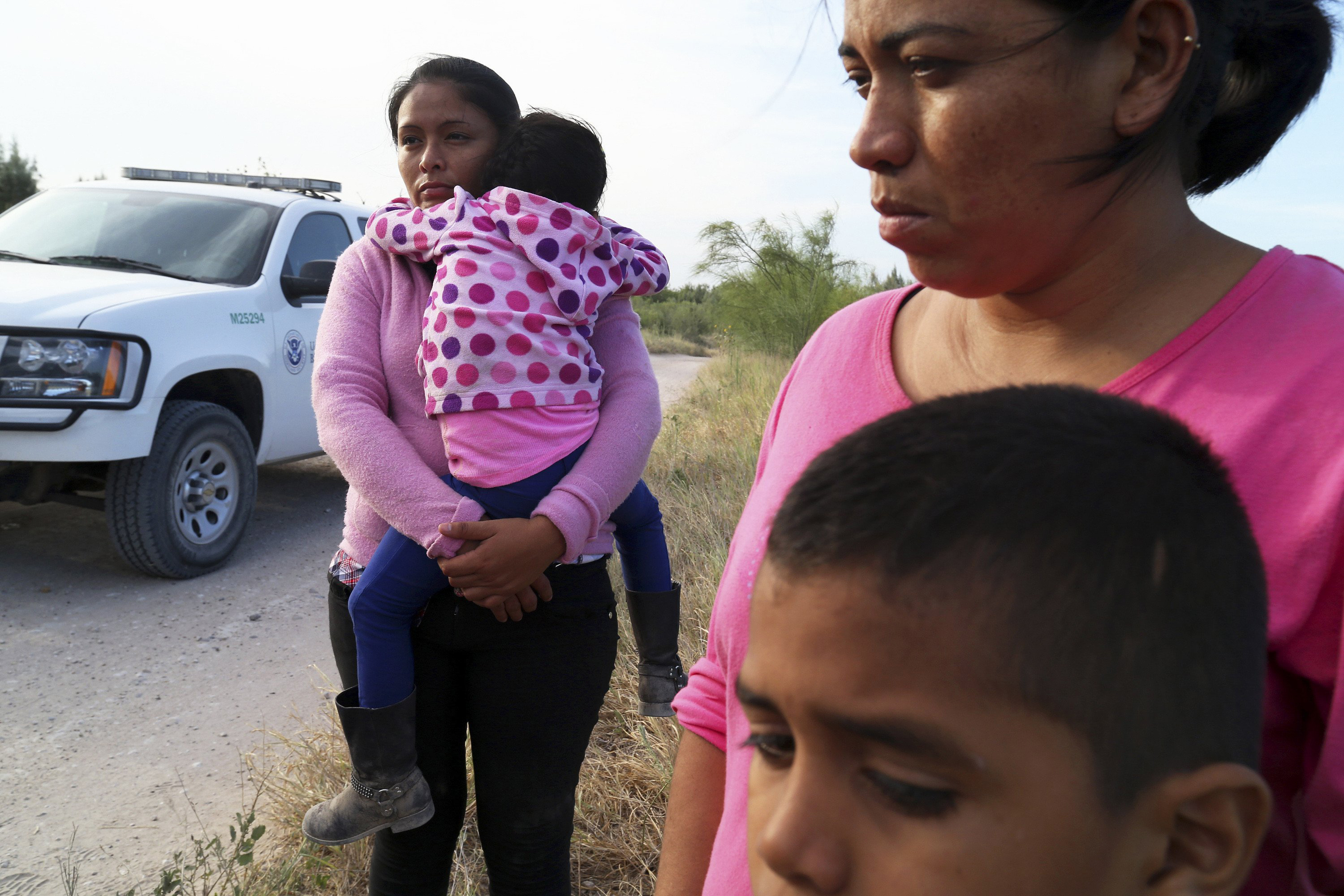 Border Patrol agents process a group of migrants from Honduras and Guatemala, mostly women and children, found walking near the Rio Grande near McAllen, Texas, June 18.