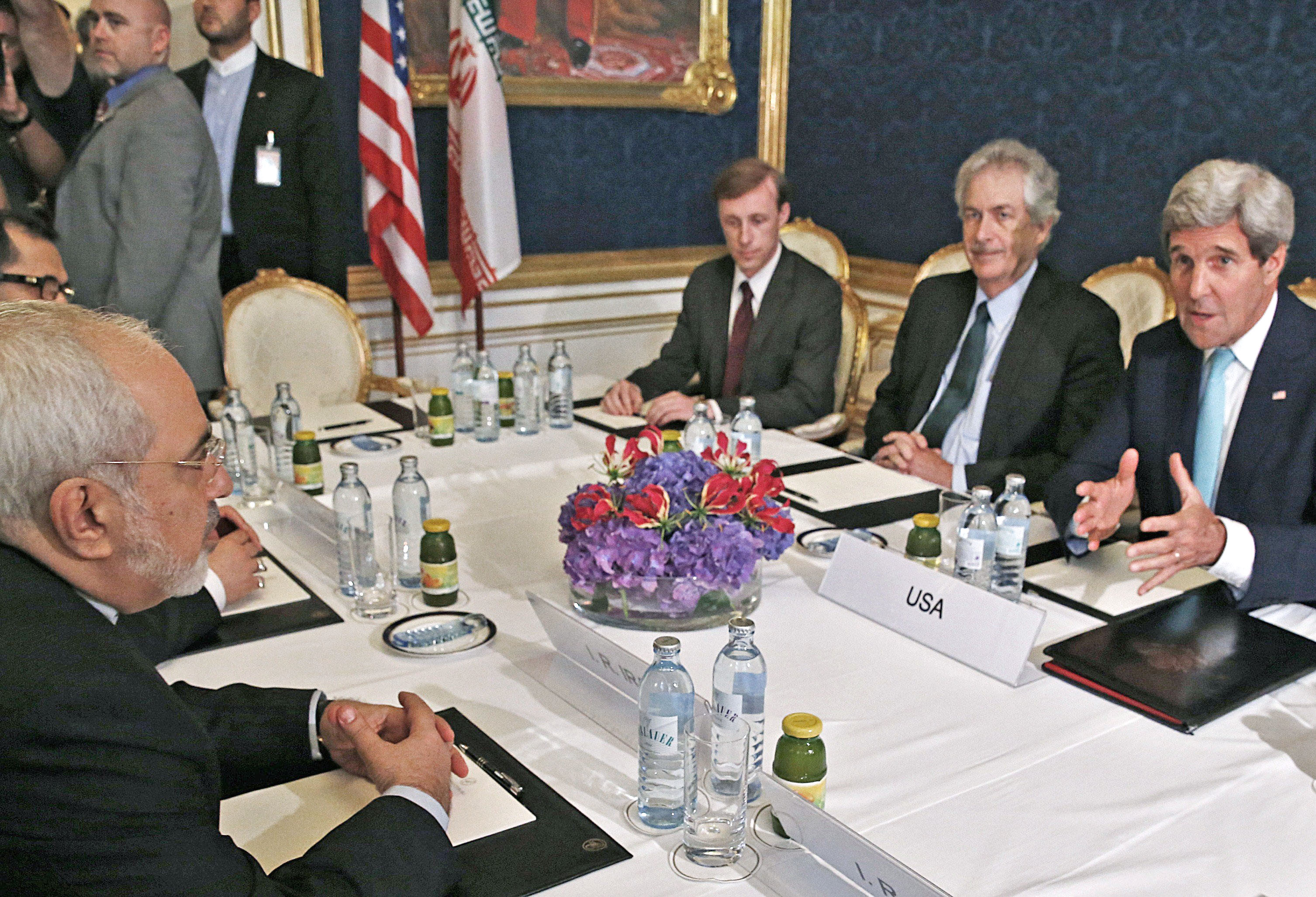 From left: Iran's Foreign Minister Mohammad Javad Zarif meets with U.S. Secretary of State John Kerry during talks between the foreign ministers of the six powers negotiating with Tehran on its nuclear program, in Vienna, on July 13, 2014.