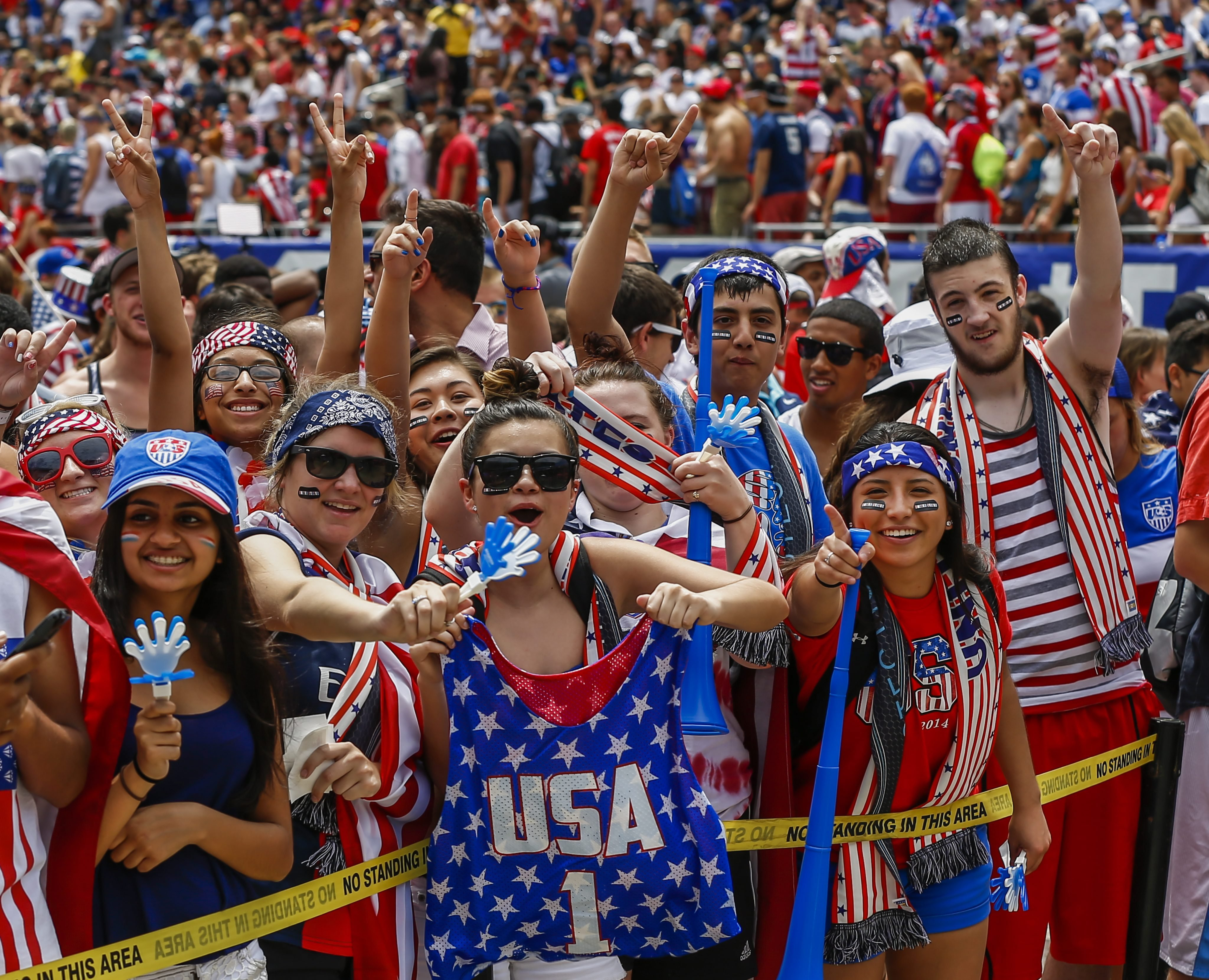 US fans cheer before the start of the FIFA World Cup Round of 16 match between the USA and Belgium played at the Arena Fonte Nova in Salvador, Brazil, at Soldier Field in Chicago, on July 1, 2014.