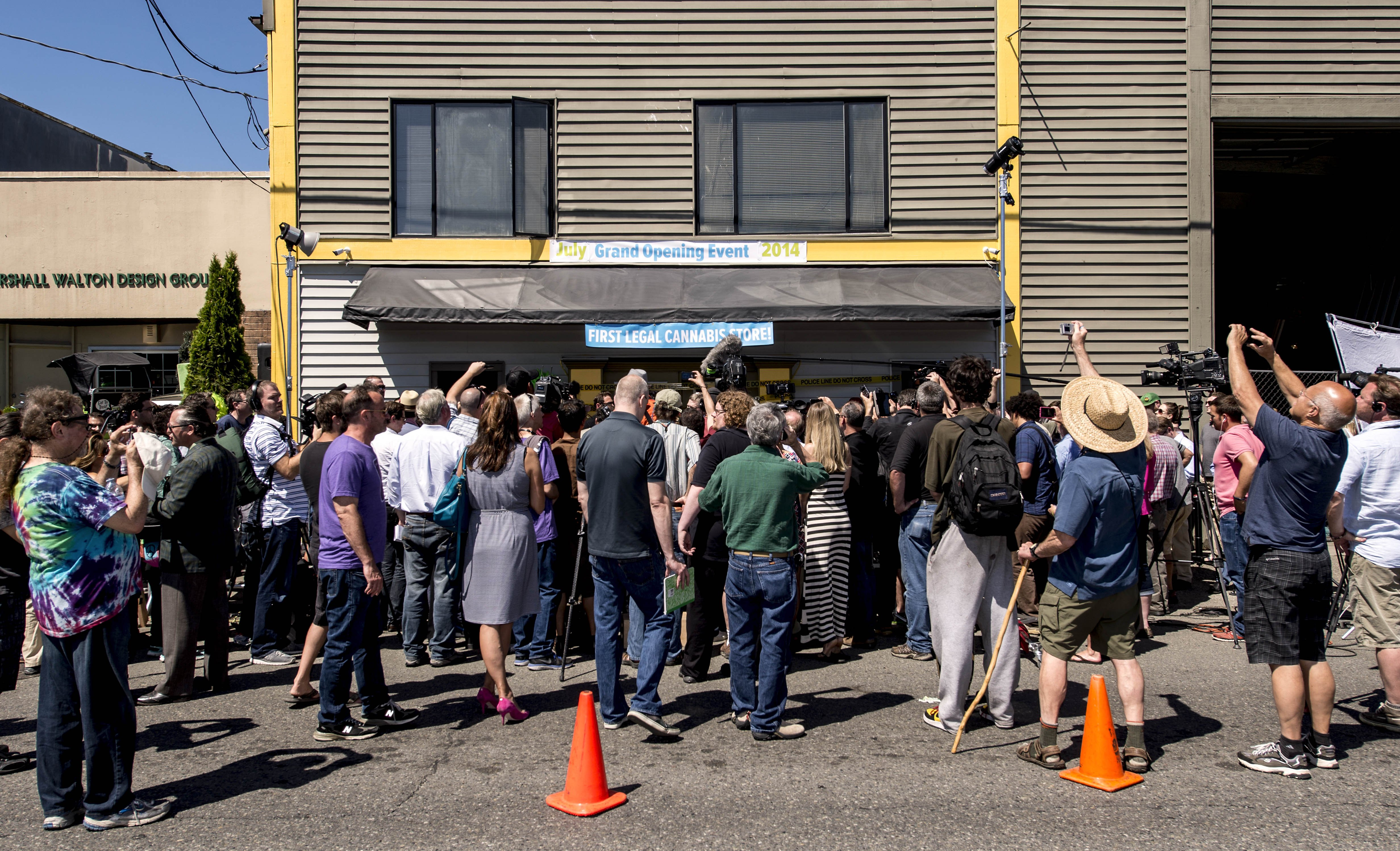 The press gathers at Cannabis City, the first dispensary with a state license to sell recreational marijuana to the public in Seattle, July 8, 2014.