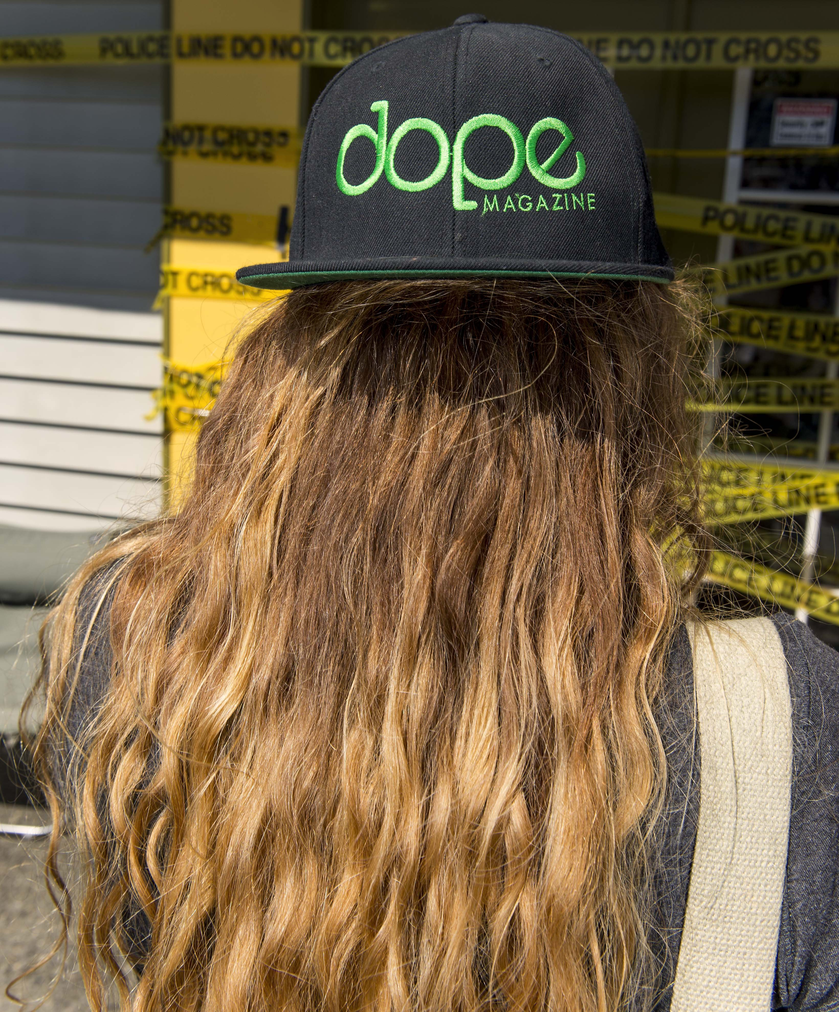 A Dope Magazine photographer takes a photo at Cannabis City in Seattle on July 8, 2014.