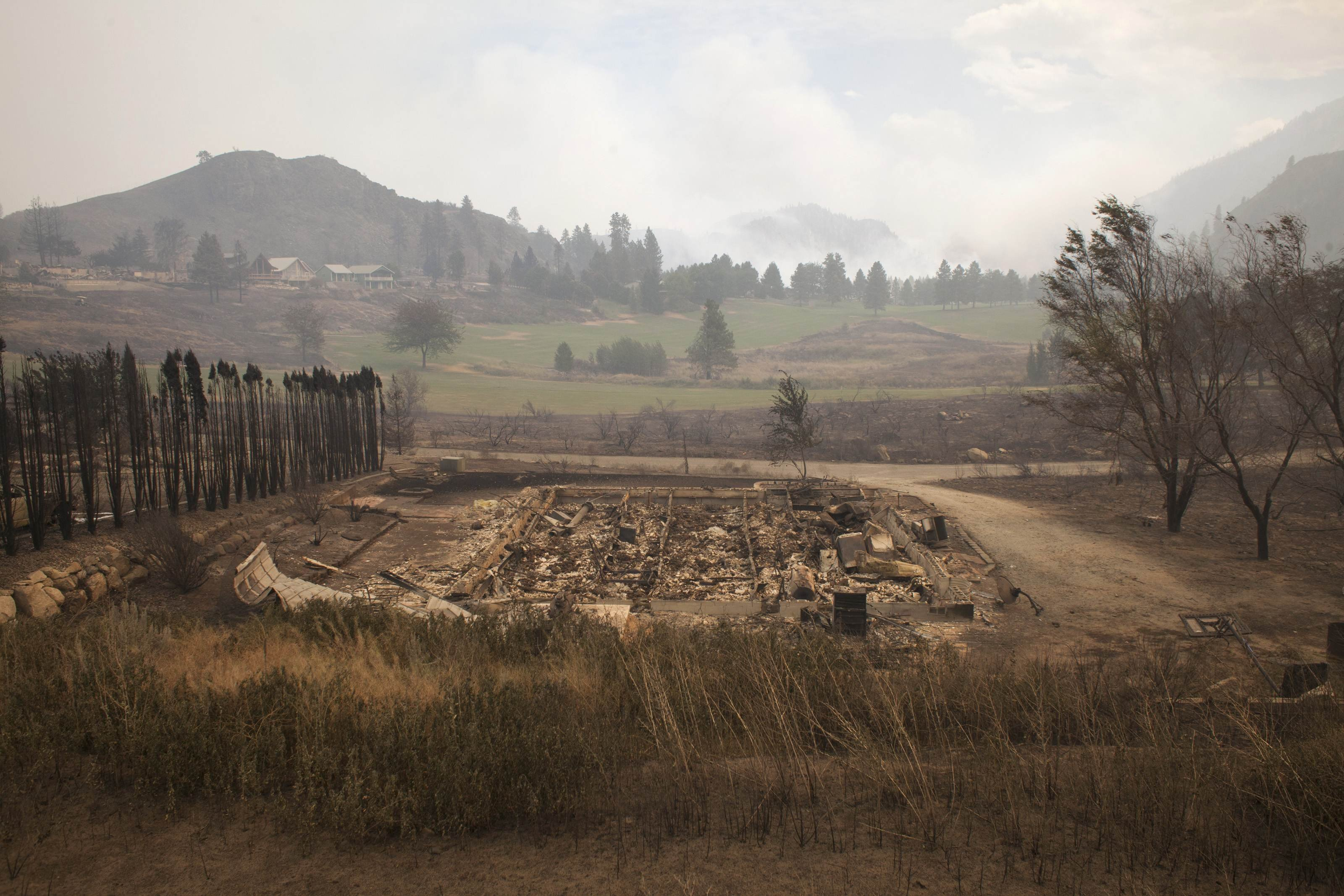 Debris from a burnt structure is pictured near Alta Lake Golf Course after much of the surrounding area was consumed by the Carlton Complex Fire near Pateros, Washington on July 19, 2014.