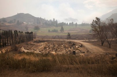 Debris from a burnt structure is pictured near Alta Lake Golf Course after much of the surrounding area was consumed by the Carlton Complex Fire near Pateros
