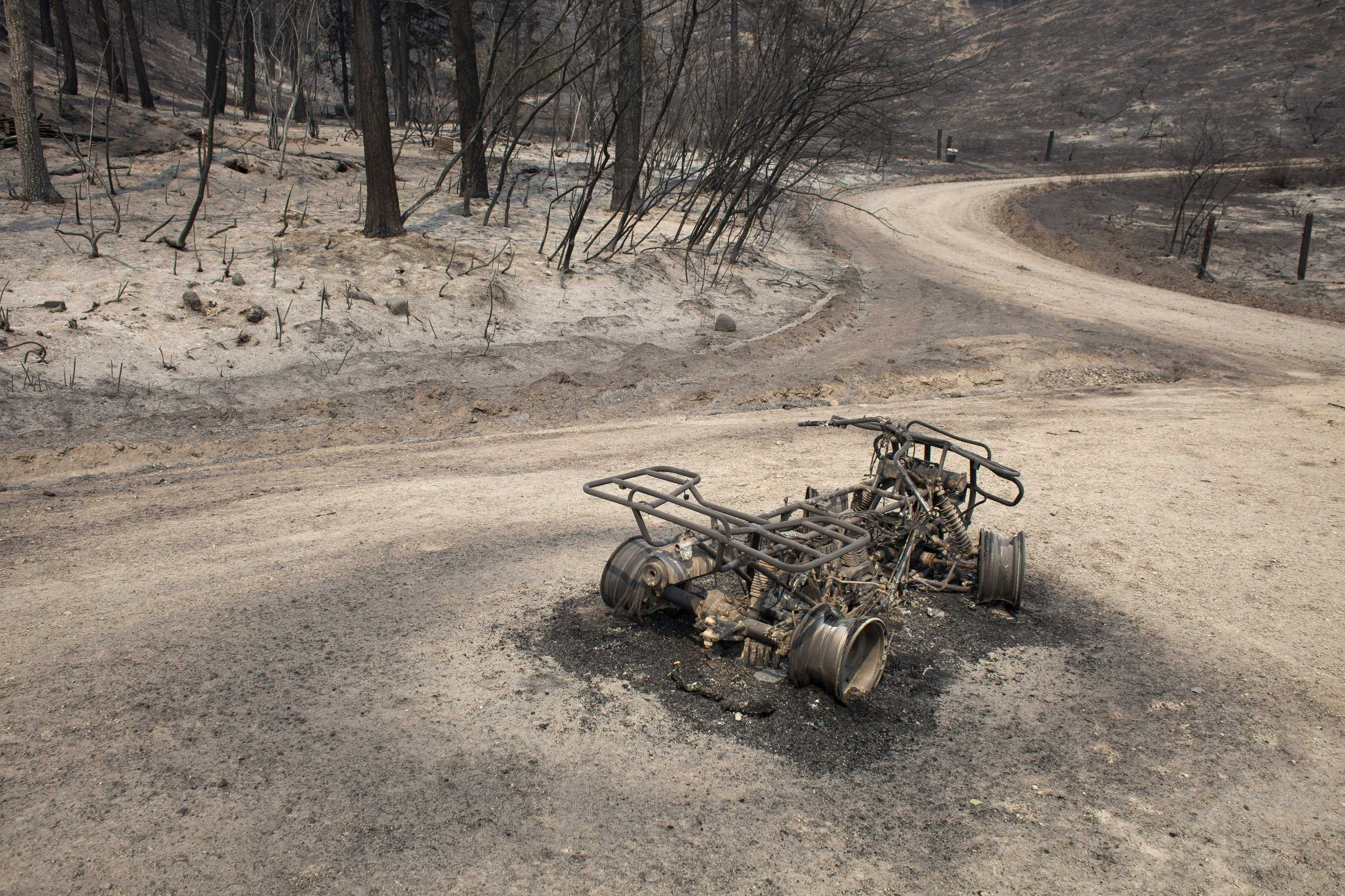 A burnt ATV lies in the road after the Carlton Complex Fire consumed an area near Malott, Washington on July 20, 2014.