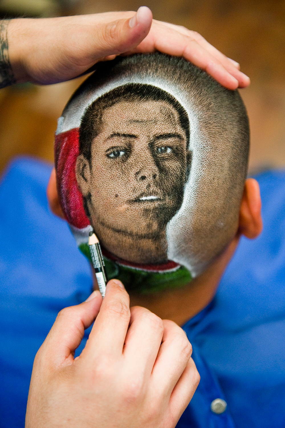 The likeness of Mexican soccer player Javier Hernández Balcazar known as  Chicharito  on the head of a customer.