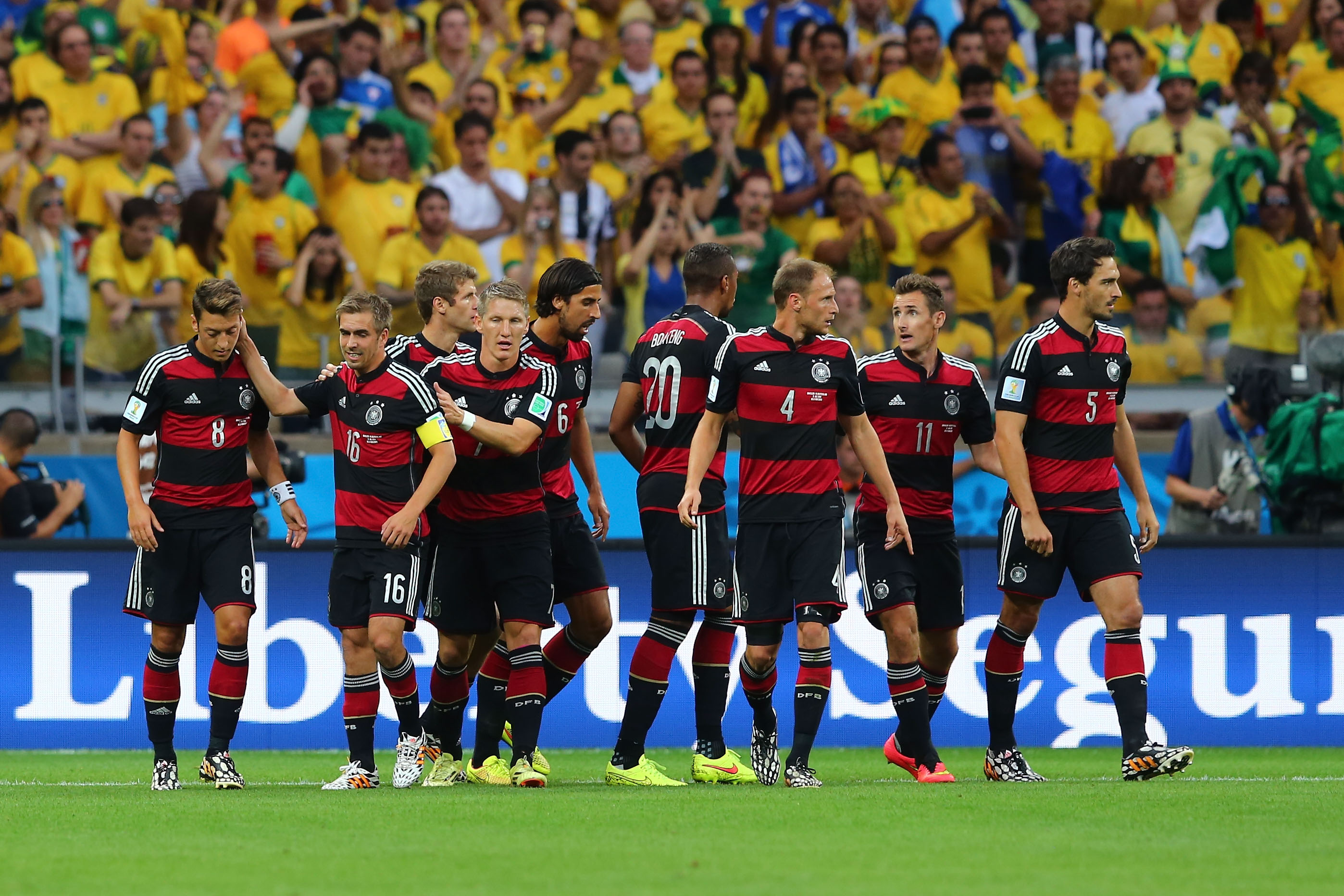 German team celebrates after scoring the opening goal during the World Cup semifinal against Brazil on July 8 in Belo Horizonte, Brazil.