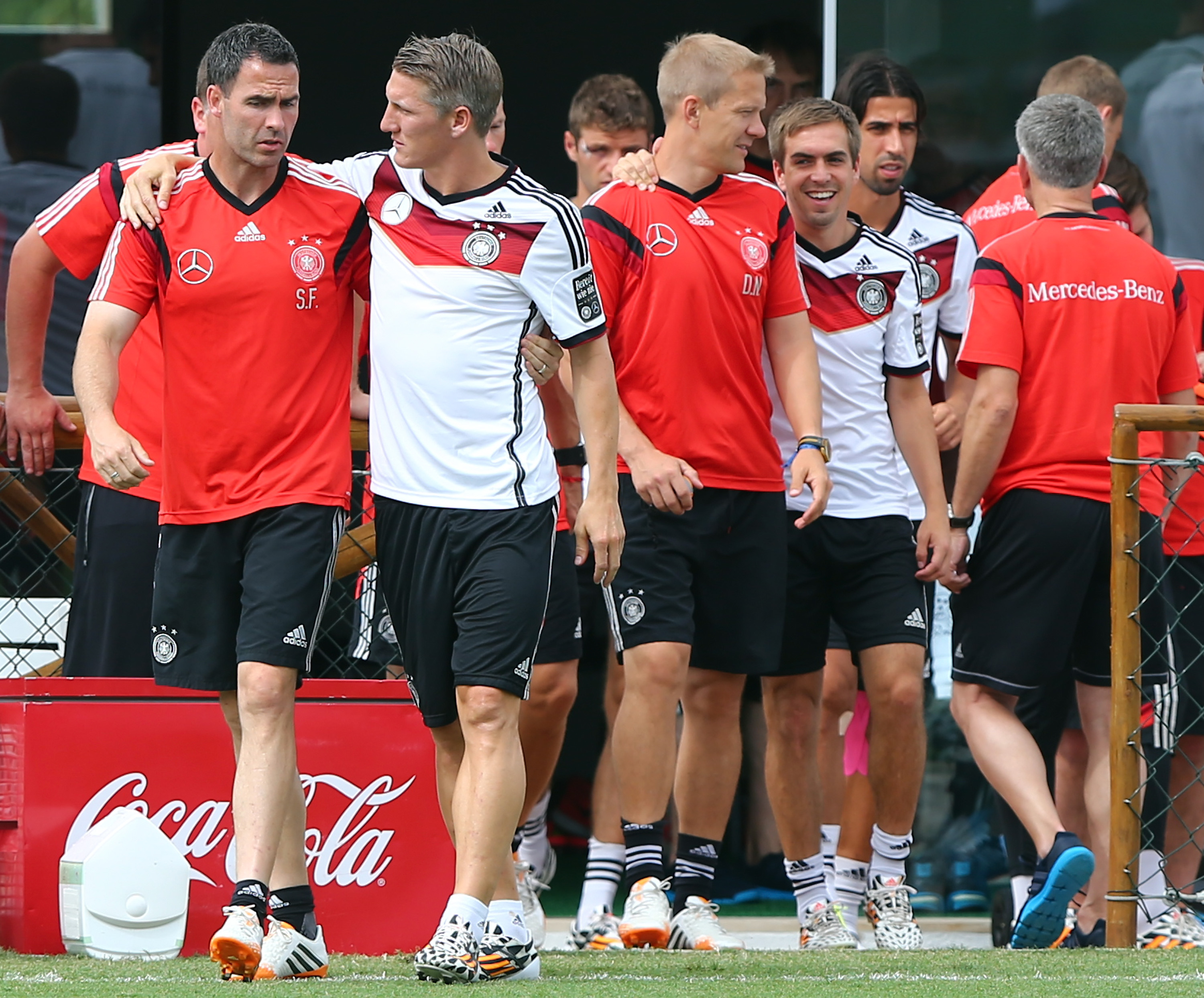 Shad Forsythe (left), assistant coach of Germany, talks to Bastian Schweinsteiger during the German national team training on June 23, 2014 in Santo Andre, Brazil.