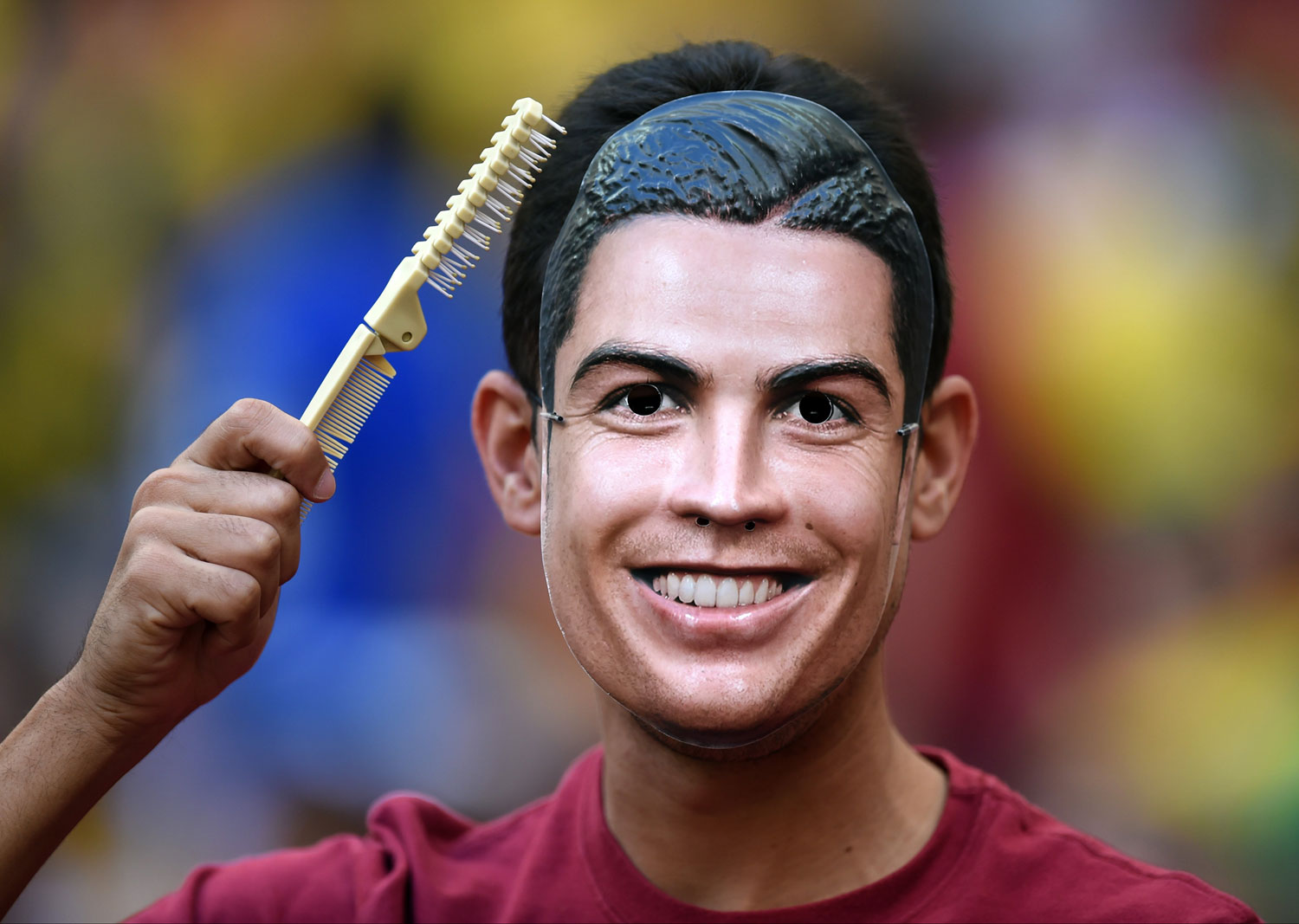 A Portugal supporter wears a Ronaldo mask before the match between Portugal and Ghana at the Estadio Nacional in Brasilia, Brazil on June 26, 2014.