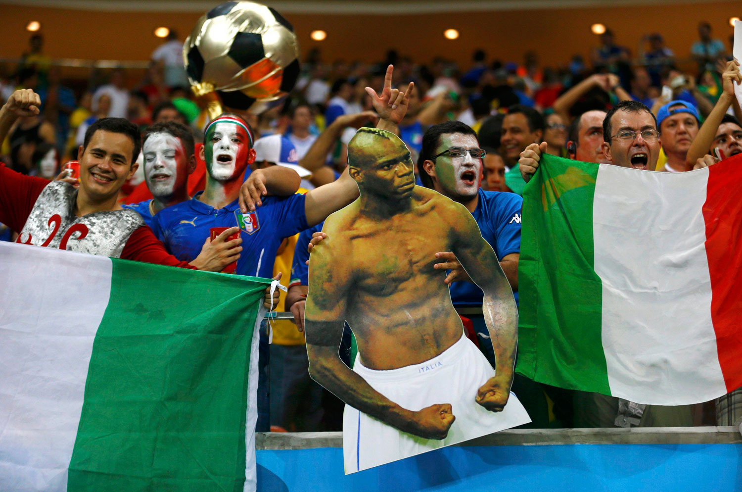 Italy fans hold a cutout of Italy's Mario Balotelli during the match between England and Italy at the Amazonia arena in Manaus, Brazil on June 14, 2014.