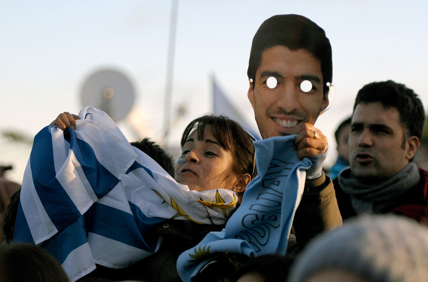 A Uruguay soccer fan holds an image of player Luis Suarez outside Suarez's home where people gather to watch the World Cup via a live telecast of the match between Uruguay and Colombia on the outskirts of Montevideo, Uruguay on June 28, 2014.