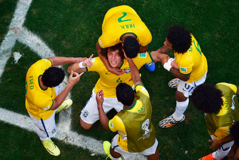 David Luiz of Brazil celebrates scoring his team's first goal with teammates at Estadio Mineirao on June 28, 2014 in Belo Horizonte, Brazil.
