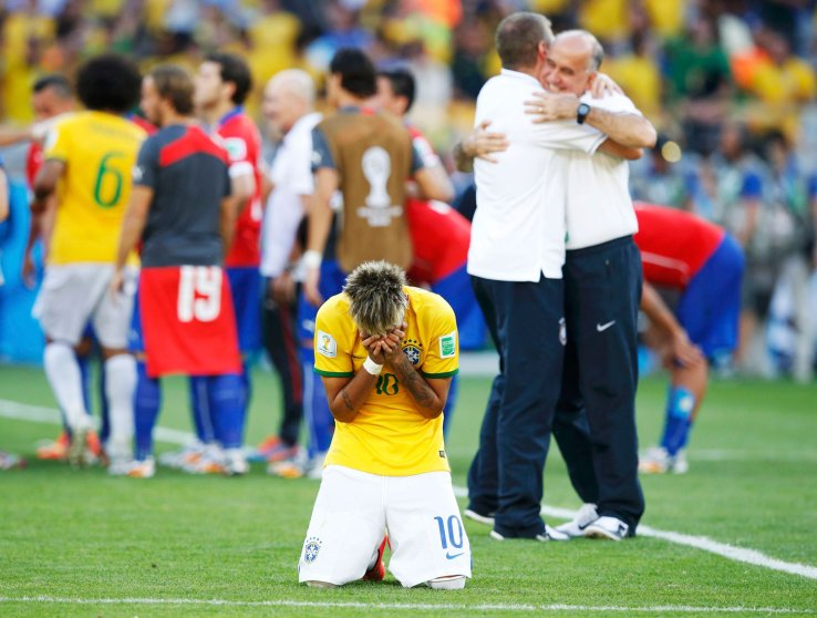 Brazil's Neymar reacts as his team celebrates their penalty shootout win against Chile at the Mineirao Stadium in Belo Horizonte, Brazil on June 28, 2014.