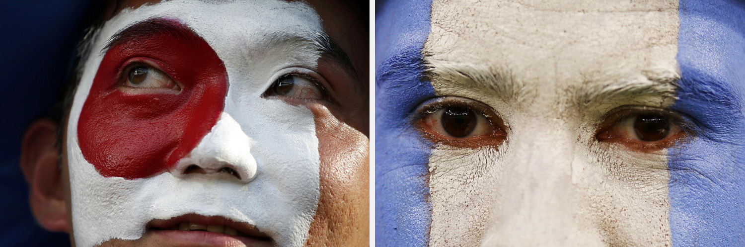 Left: A Japan fan looks on before the 2014 World Cup Group C soccer match against Colombia at the Pantanal arena Right: A fan of Argentina waits for the start of their 2014 World Cup match against Bosnia at the Maracana stadium in Rio de Janeiro.