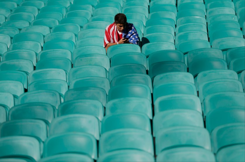 A US fan waits for the beginning of the match between Belgium and the USA at the Arena Fonte Nova in Salvador, Brazil on July 1, 2014.