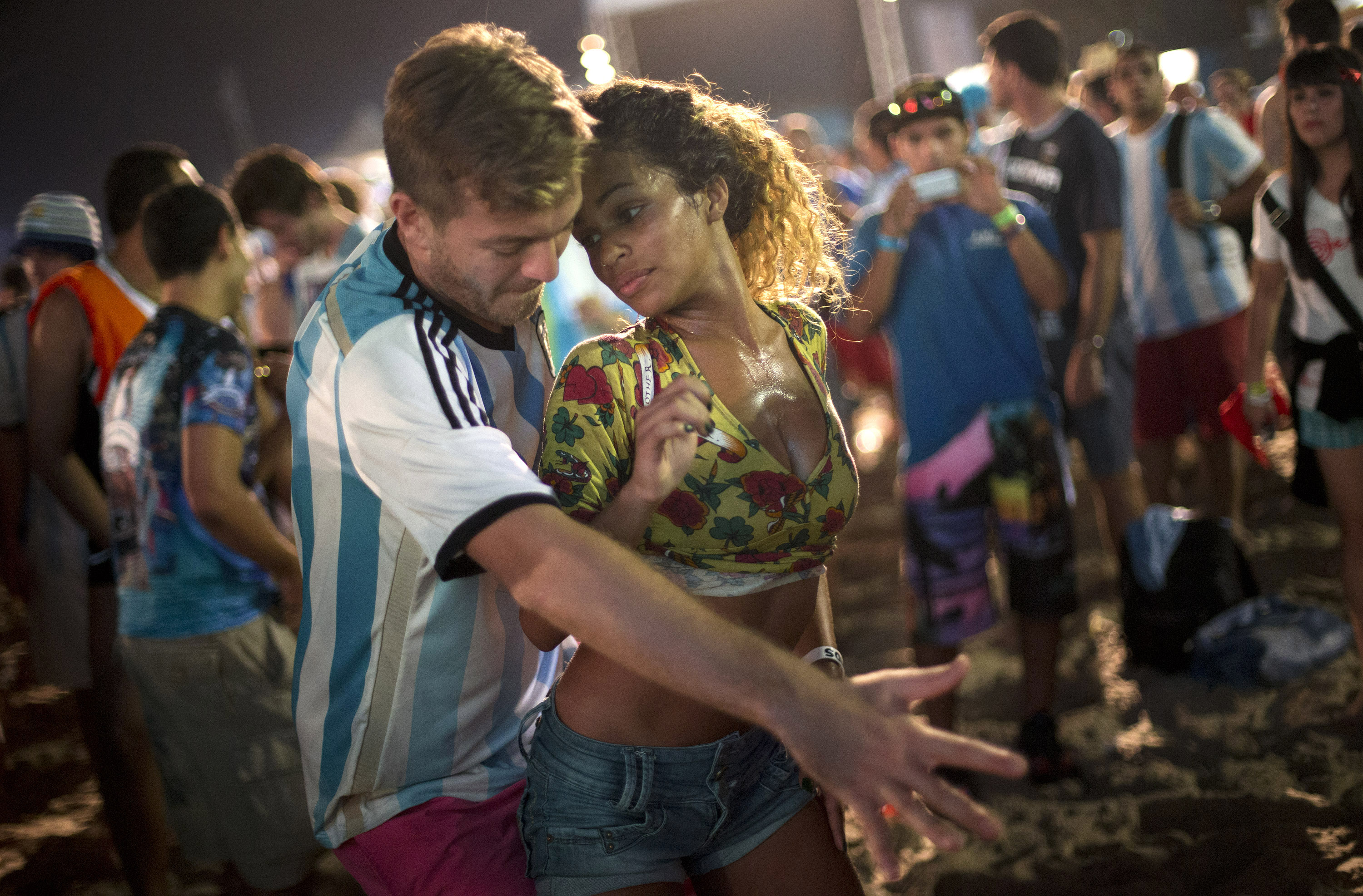 A woman from Brazil and a man from Argentina dance samba at the World Cup Fan Fest 2014, on Copacabana beach, in Rio de Janeiro on July 9, 2014.