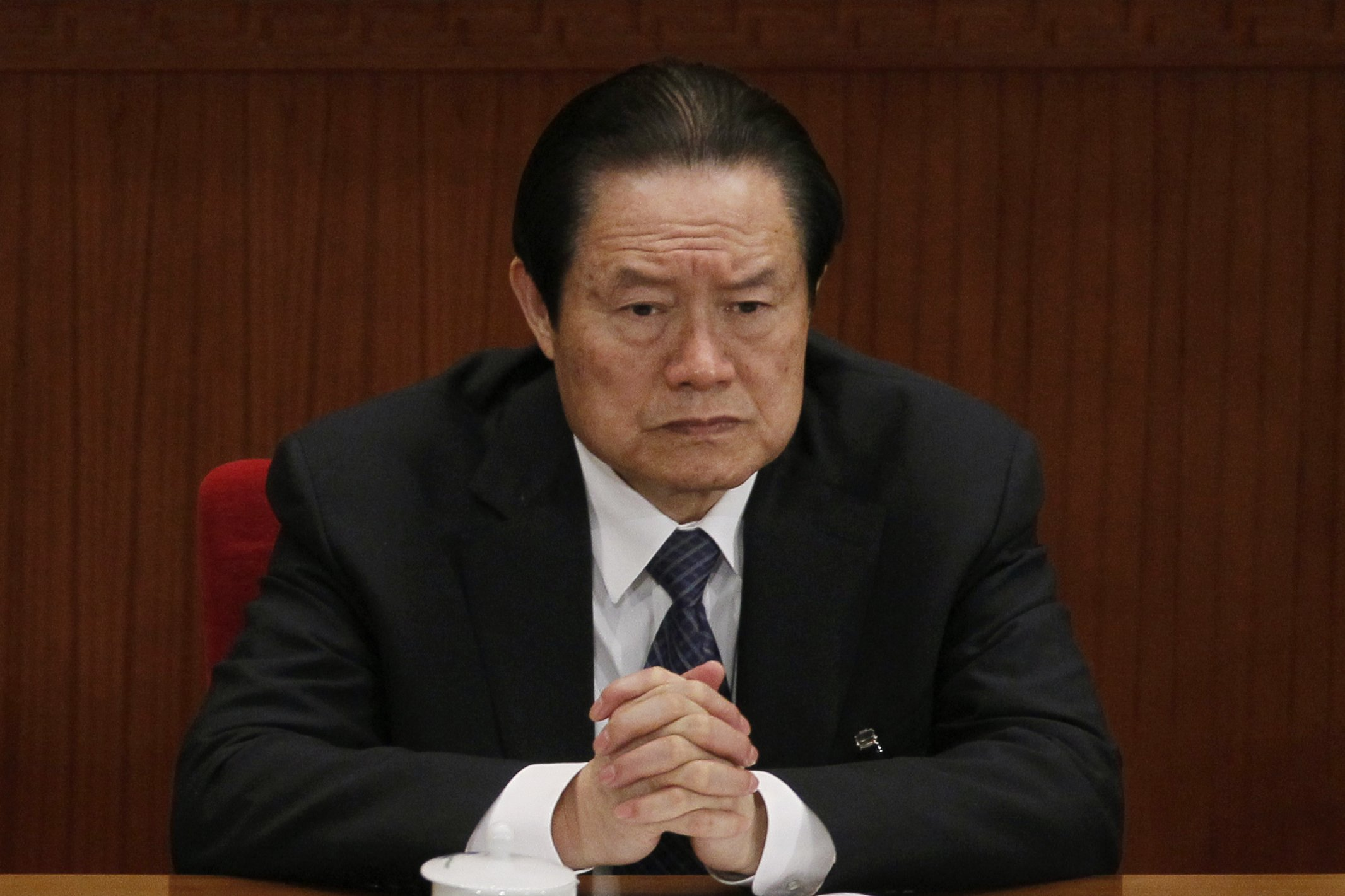 Zhou Yongkang, then Chinese Communist Party Politburo Standing Committee member in charge of security, attends a plenary session of the National People's Congress at the Great Hall of the People in Beijing on March 9, 2012