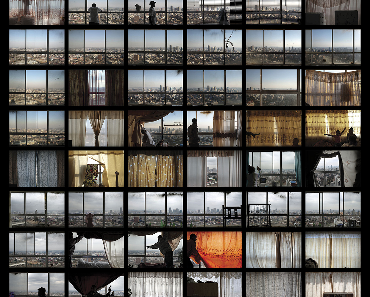 A section of our combined lightbox that puts together a photograph from every window in the building. The photographs are arranged exactly true to the architecture, flat-by-flat and floor-by-floor.