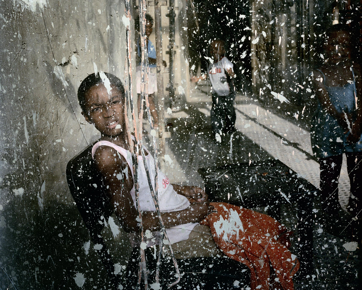 A girl photographed in the Ponte City entrance-way through a dirty window at the height of the 2008 reconstruction.